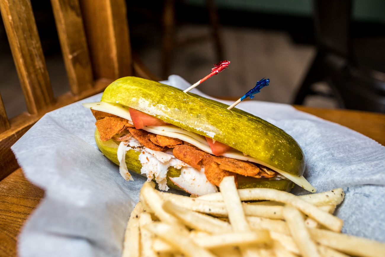 Cincy Turkey Sandwich: turkey, tomato, pepper jack cheese, and Grippo's BBQ chips served on a pickle with a side of fries / Image: Catherine Viox // Published: 2.1.21