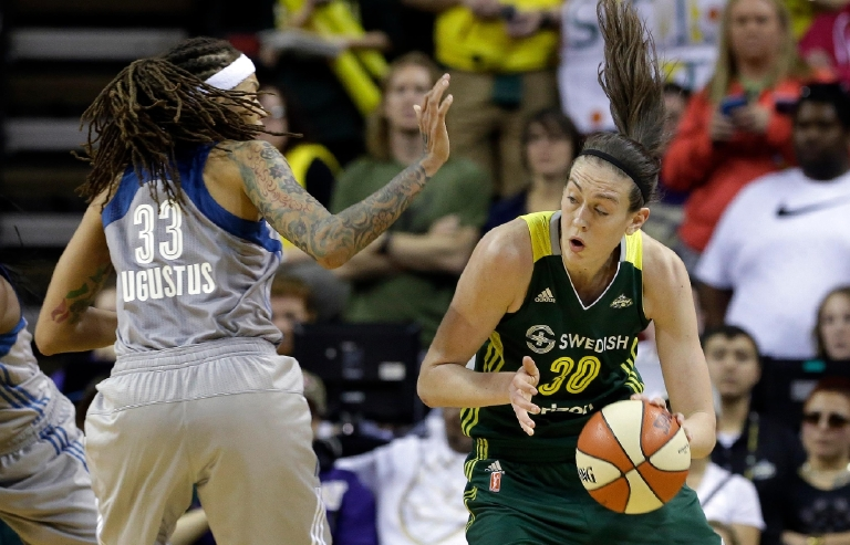 Seattle Storm's Breanna Stewart (30) drives as Minnesota Lynx's Seimone Augustus defends in the second half of a WNBA basketball game Sunday, May 22, 2016, in Seattle. The Lynx won 78-71. (AP Photo/Elaine Thompson)