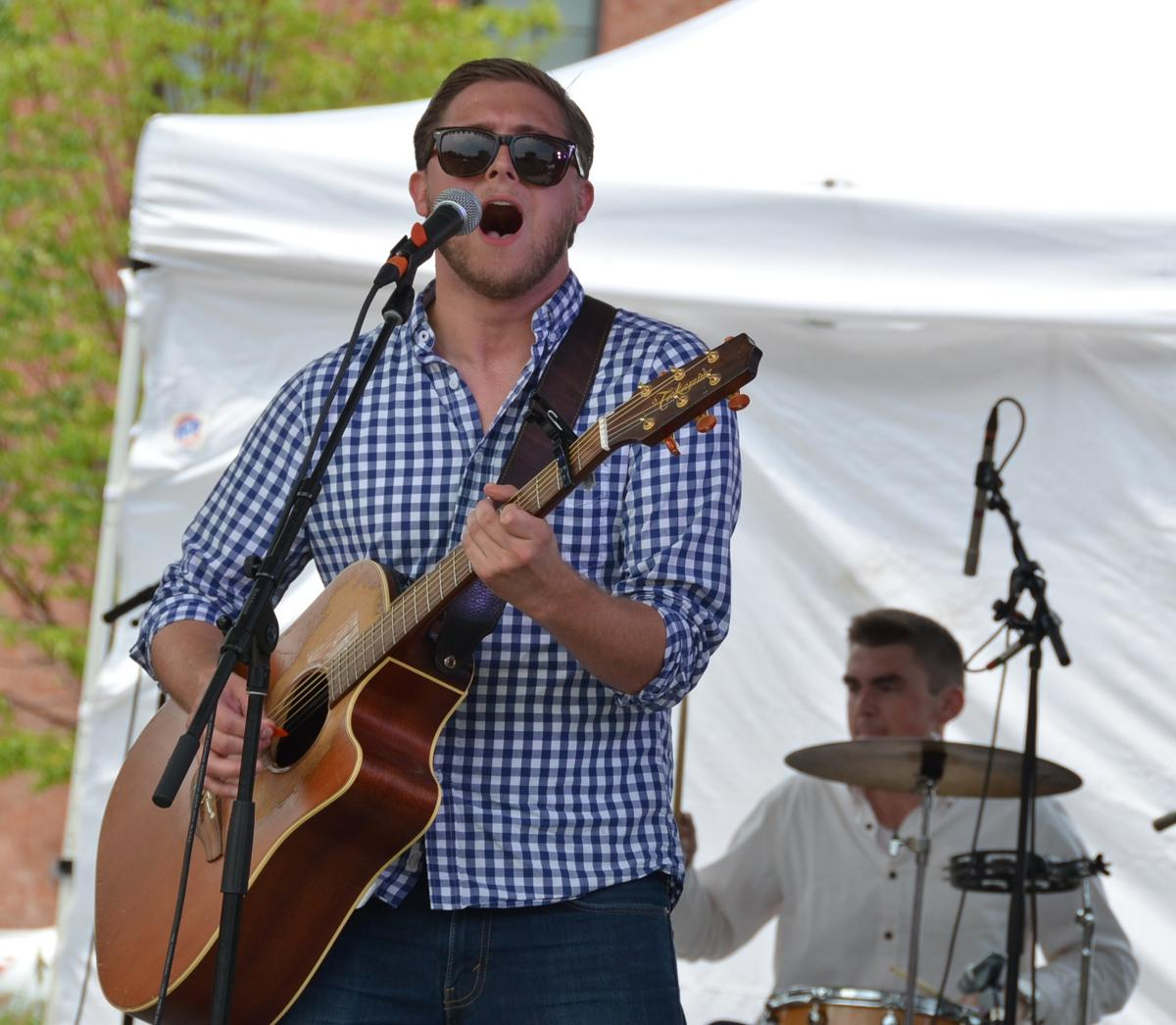 Lead singer of The Ridges performing at The Taste of OTR on Saturday, July 26 at Washington Park (Image: Leah Zipperstein / Cincinnati Refined)