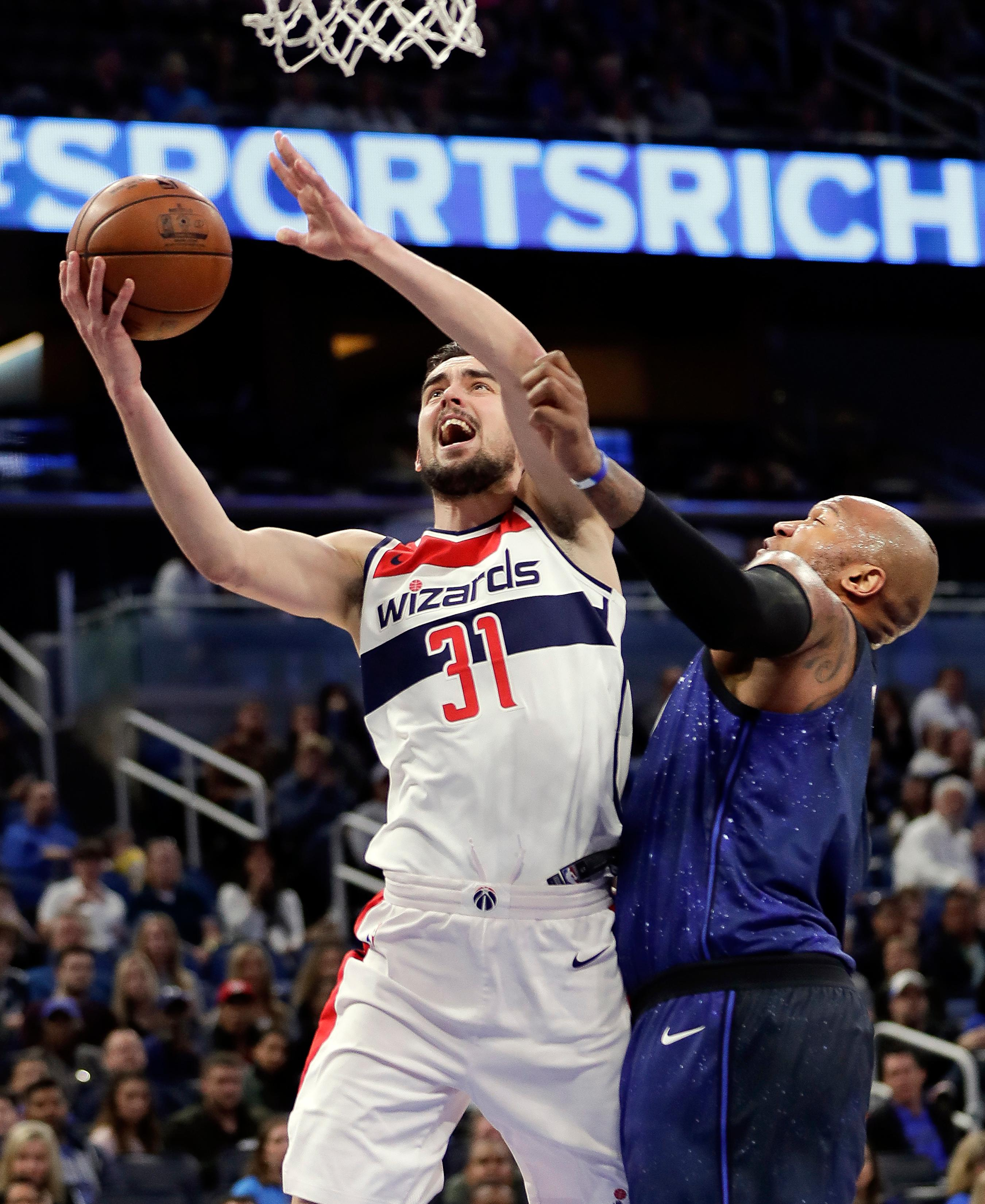 Washington Wizards' Tomas Satoransky (31) gets around Orlando Magic's Marreese Speights, right, for a shot during the first half of an NBA basketball game Saturday, Feb. 3, 2018, in Orlando, Fla. (AP Photo/John Raoux)