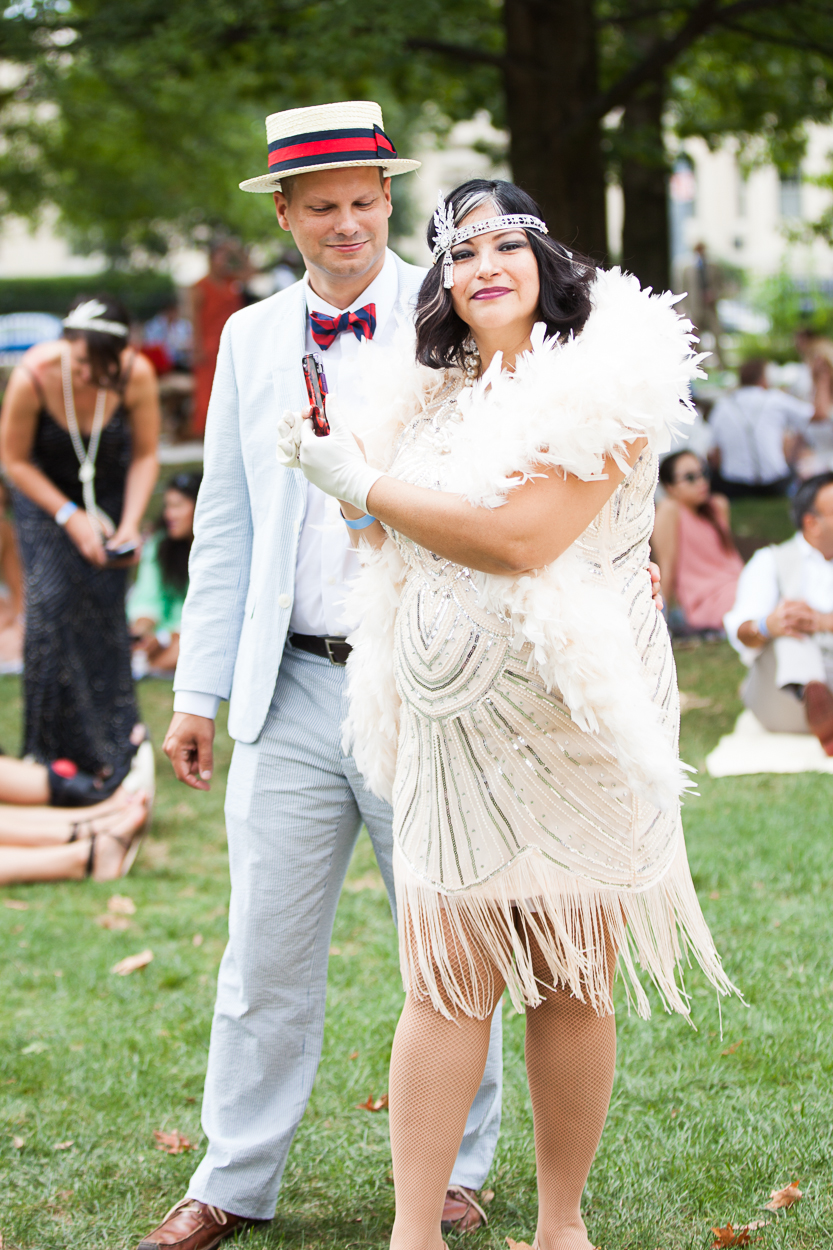 "Washingtonians showed up in droves on Saturday to celebrate the opulence of the Roaring 20s, dressed in period attire! Sprawled out on the lawn of the National Cathedral, guests immediately felt transported to another era, where flapper dresses, boater hats, croquet, Prohibition cocktails and 11-piece orchestras reigned supreme.  Sponsored by Dardanella, it was the New York City-based company's inaugural event in the District, but they will return in January for ""The Great Gatsby Presidential Inaugural Ball."" (Image: Jay Snap/LaDexon Photographie)"
