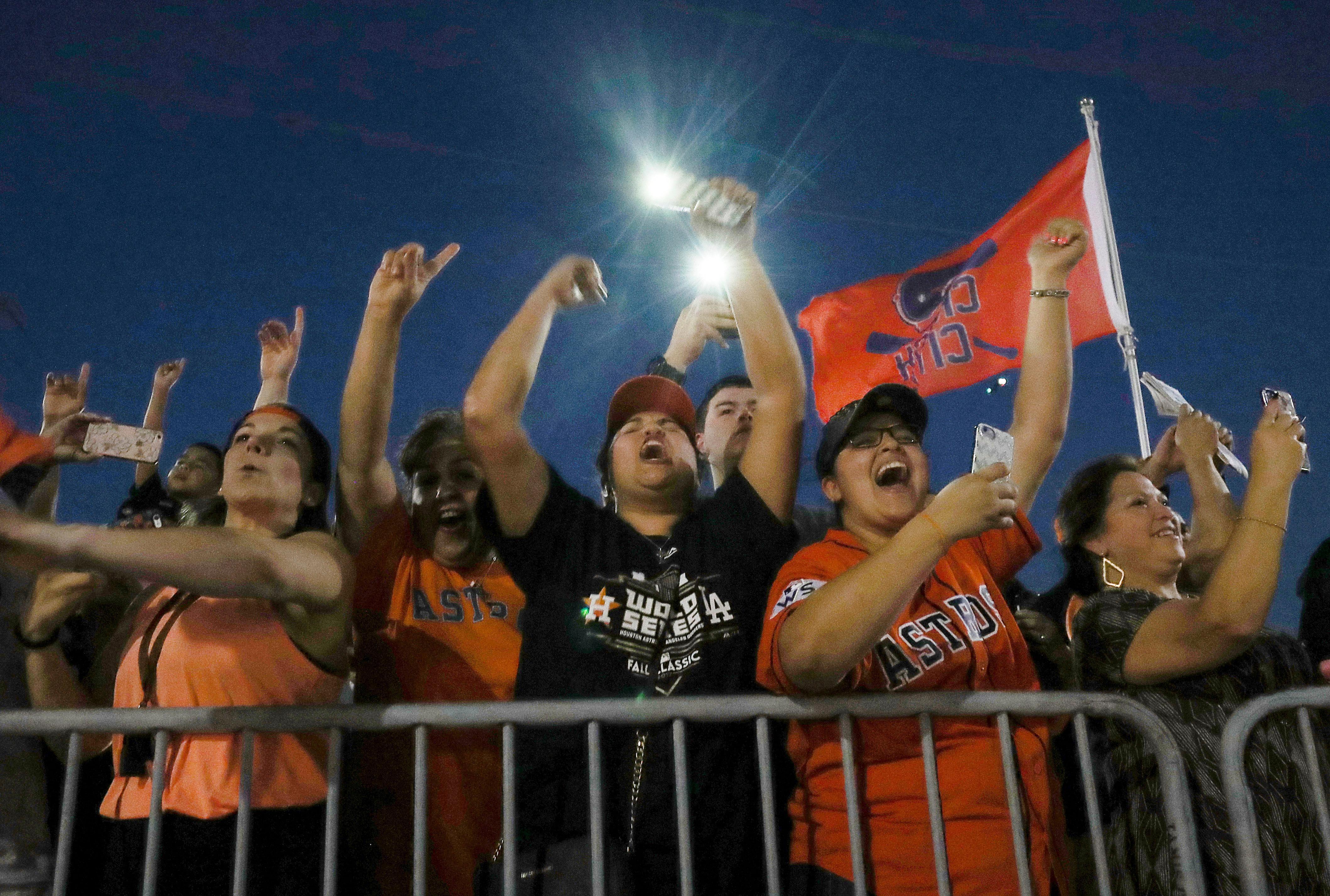 Fans cheer as the Houston Astros return to Minute Maid Park after winning the 2017 World Series, Thursday, Nov. 2, 2017, in Houston. (Jon Shapley/Houston Chronicle via AP)