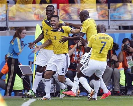 Colombia's Teofilo Gutierrez, centre, celebrates after scoring his side's second goal during the group C World Cup soccer match between Colombia and Greece at the Mineirao Stadium in Belo Horizonte, Brazil Saturday.