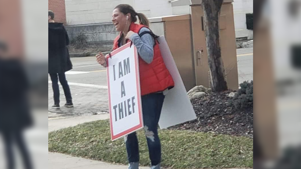 Lu Ann - woman holding I Am A Thief sign for web.png