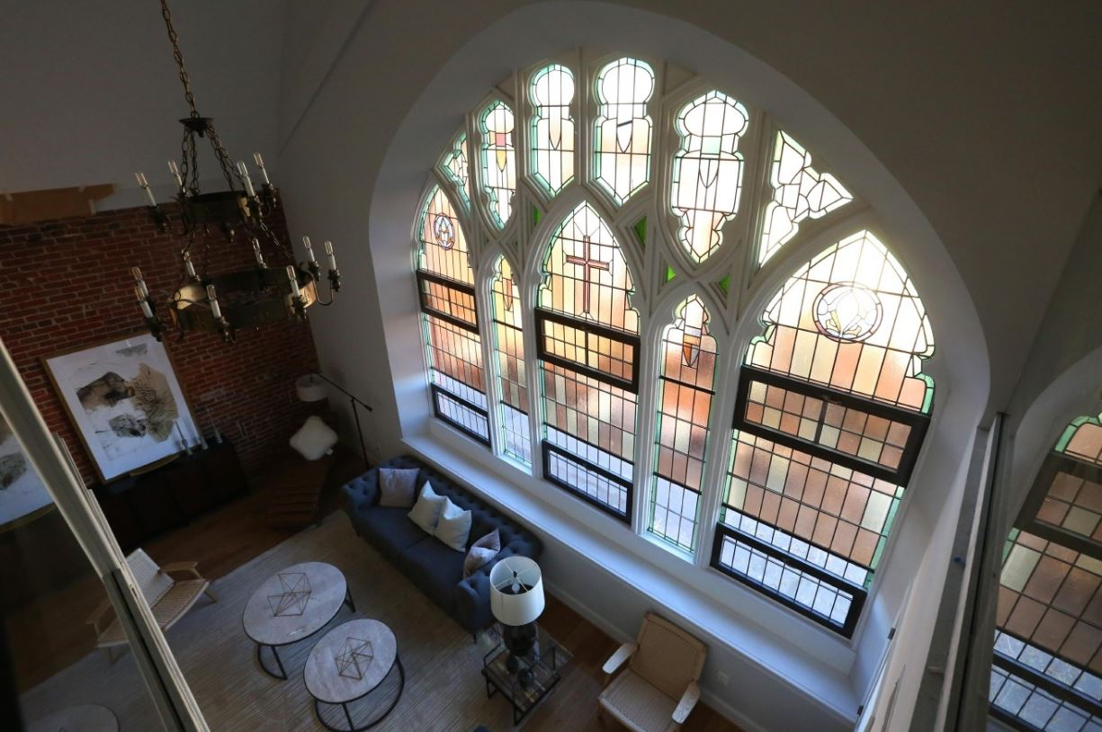 When the congregation of the Way of the Cross Church of Christ on Capitol Hill outgrew its 119-year-old church, The Rubin Group took a leap of faith and converted the building to a 30-unit condominium. Founder Andrew Rubin says he intentionally kept some of the church's elements intact, like the painstakingly restored stained glass windows. Most of the condos, which start in the $300,000s have been sold, but the $1.7 million penthouse, is still on the market. (Image: Amanda Andrade-Rhoades)
