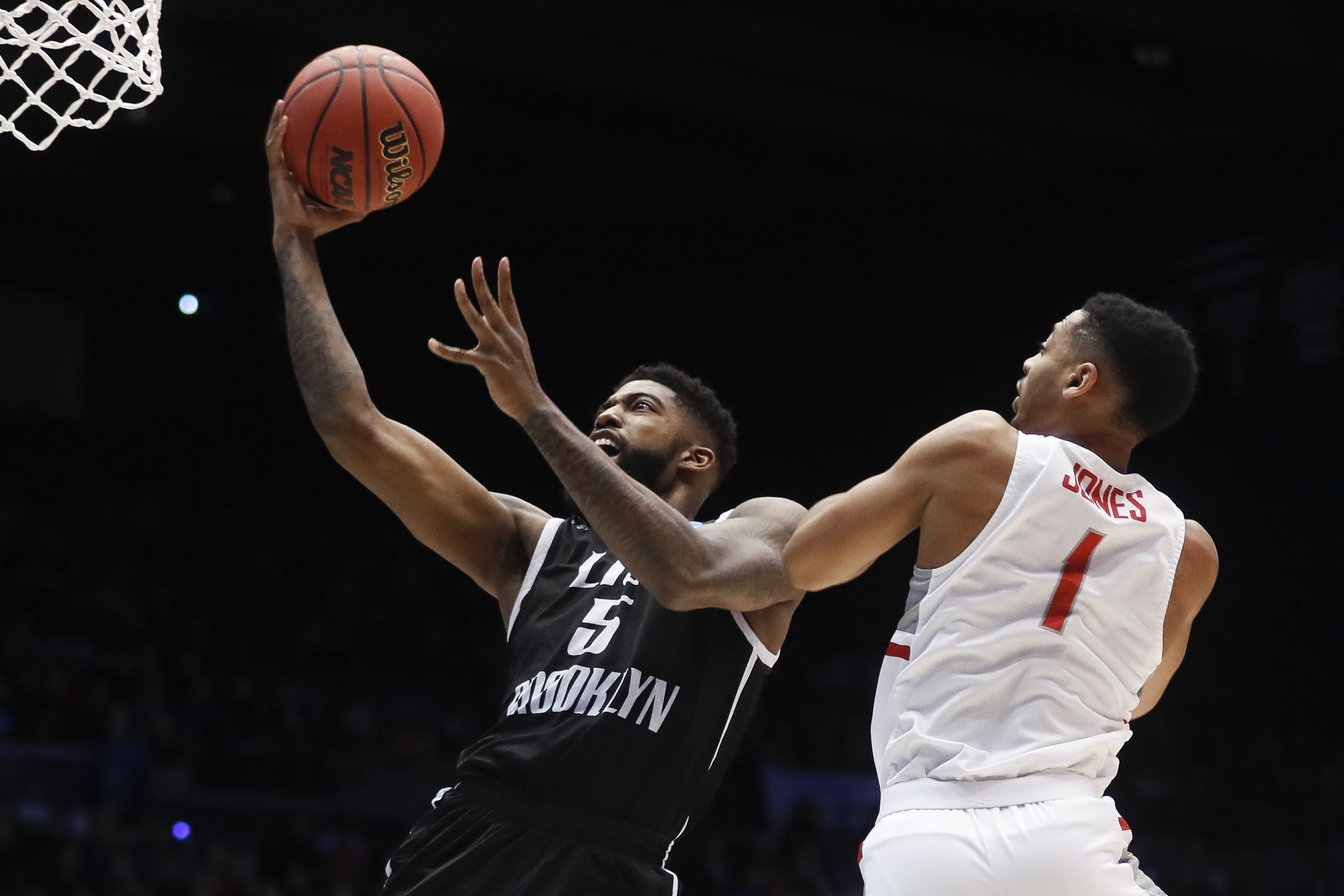 LIU Brooklyn's Zach Coleman (5) shoots against Radford's Carlik Jones (1) during the first half of a First Four game of the NCAA men's college basketball tournament, Tuesday, March 13, 2018, in Dayton, Ohio. (AP Photo/John Minchillo)