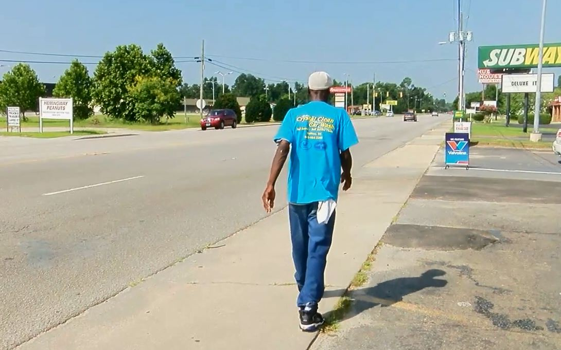 Doug Legette walking near his work, Crystal Clear Car Wash. (Rosalia Fodera/WPDE)