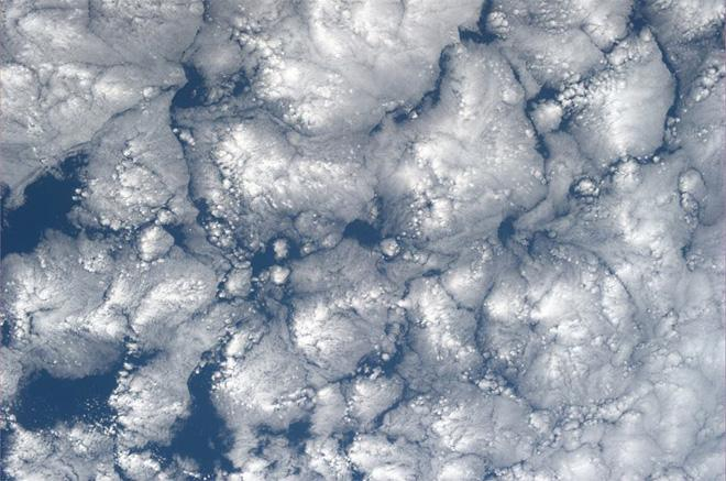 To me, these clouds look like bacteria growth. (Photo & Caption: Karen Nyberg, NASA)