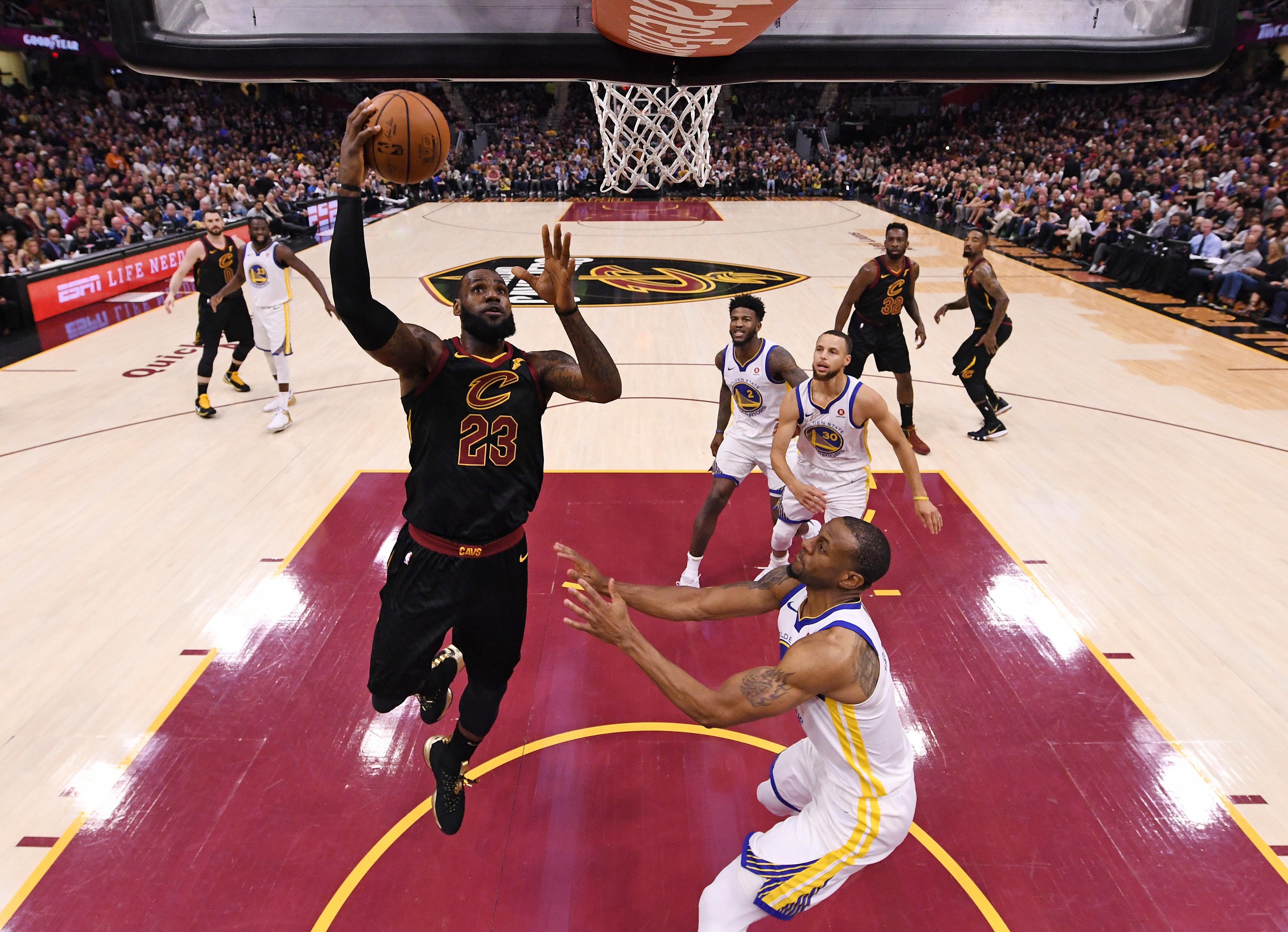 Cleveland Cavaliers' LeBron James shoots during the first half of Game 4 of basketball's NBA Finals against the Golden State Warriors, Friday, June 8, 2018, in Cleveland. (Gregory Shamus/Pool Photo via AP)