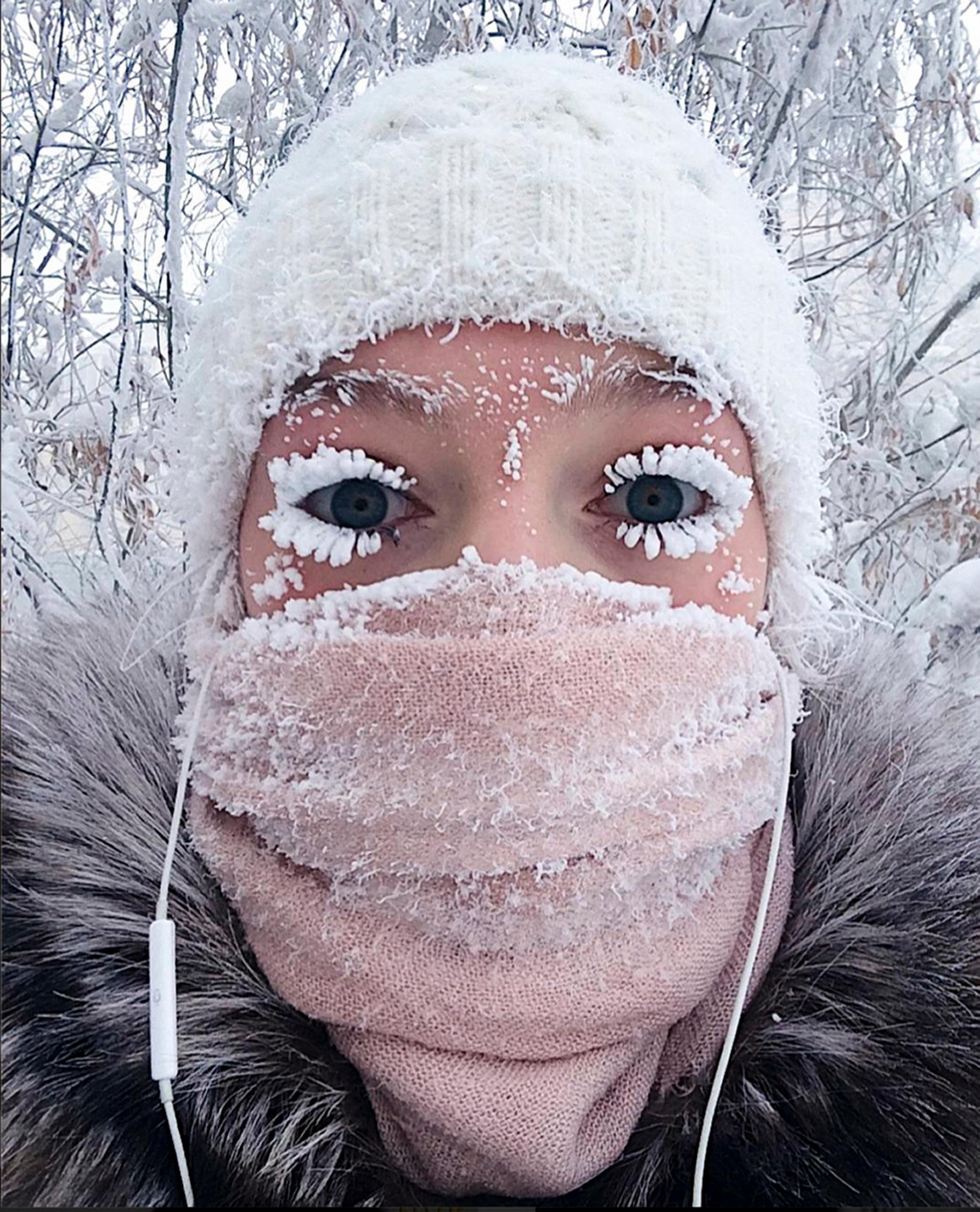 In this photo taken on Sunday, Jan. 14, 2018, Anastasia Gruzdeva poses for selfie as the Temperature dropped to about -50 degrees (-58 degrees Fahrenheit) in Yakutsk, Russia. Temperatures in the remote, diamond-rich Russian region of Yakutia have dropped to near-record lows, plunging to -67 degrees Centigrade (-88.6 degrees Fahrenheit) in some areas. (sakhalife.ru photo via AP)