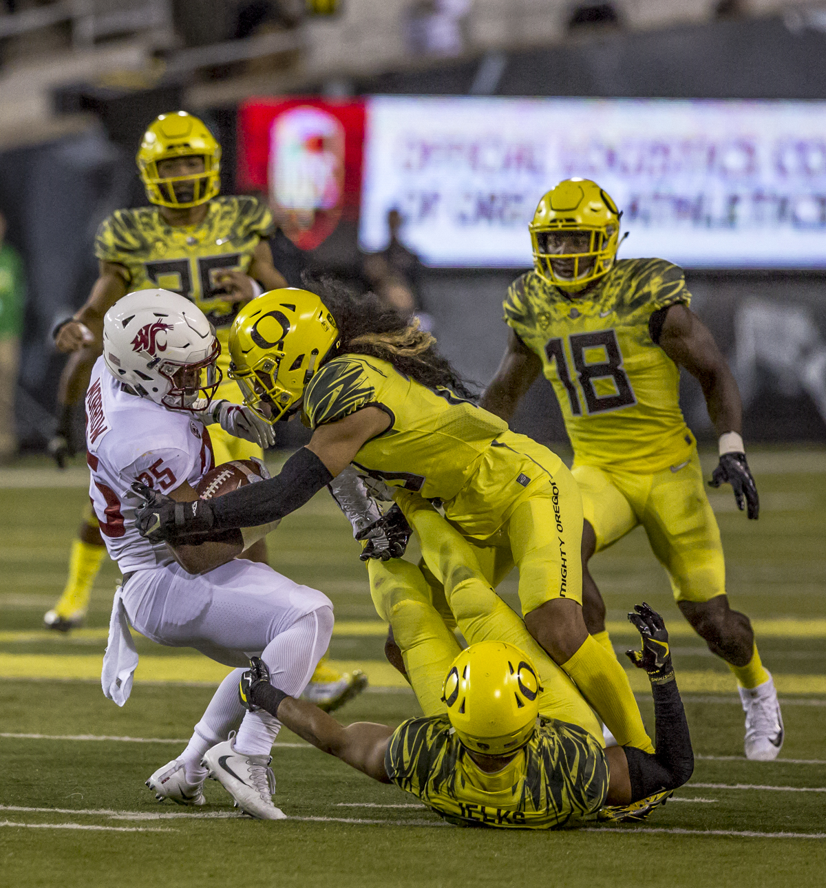Oregon defensive player Fotu T. Leiato II tackles Washington State running back Jamal Morrow (#25). The Washington State Cougars defeated the Oregon Ducks 33 to 10 on Saturday, October 7, 2017. Saturday's game was the first home loss for the Ducks under new head coach Willie Taggart. Photo by Ben Lonergan, Oregon News Lab