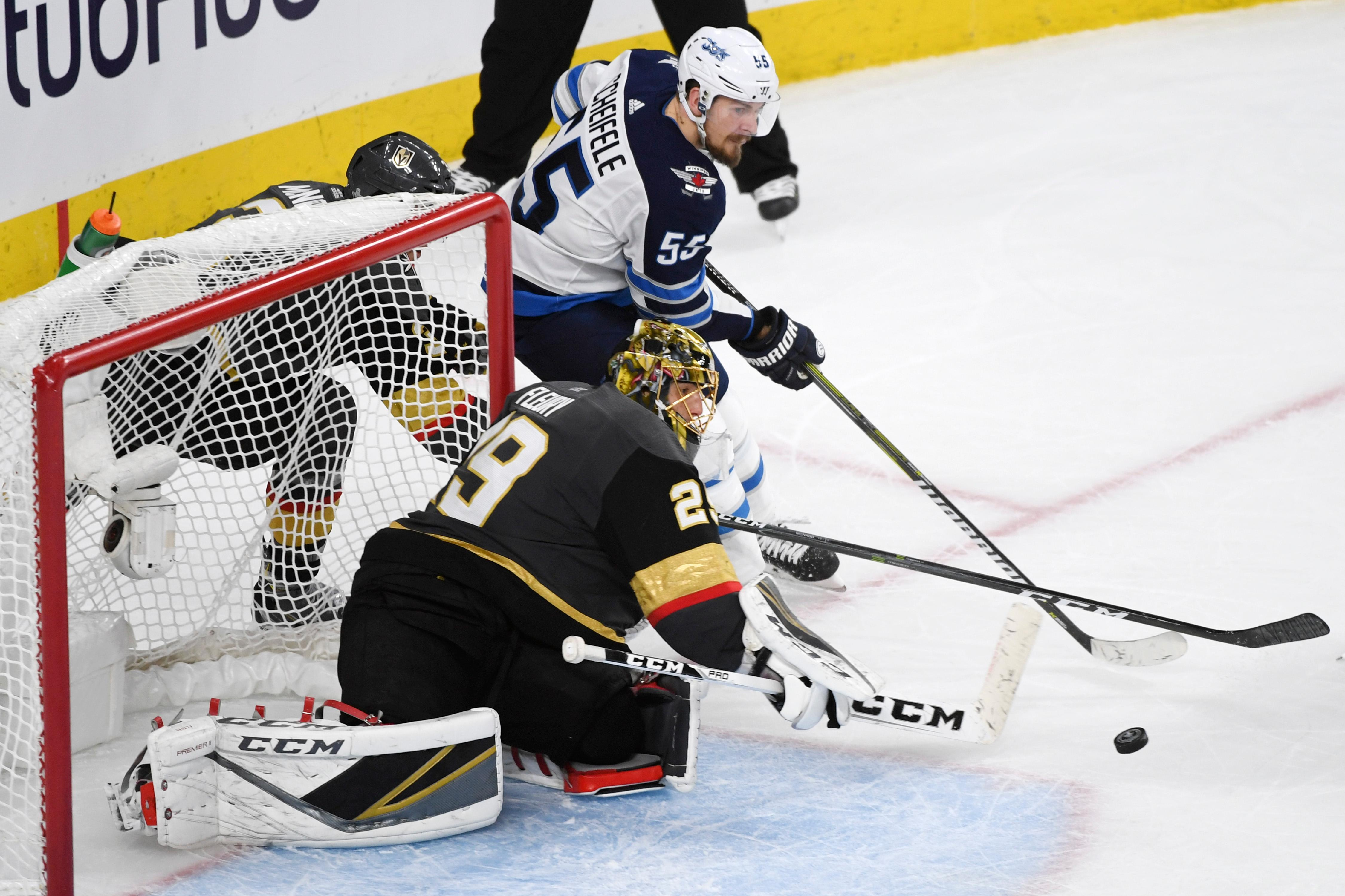Vegas Golden Knights goaltender Marc-Andre Fleury (29) stops a shot by Winnipeg Jets center Mark Scheifele (55) during Game 3 of their NHL hockey Western Conference Final game Wednesday, May 16, 2018, at T-Mobile Arena. The Golden Knights won 4-2 to take a 2-1 lead in the series. CREDIT: Sam Morris/Las Vegas News Bureau
