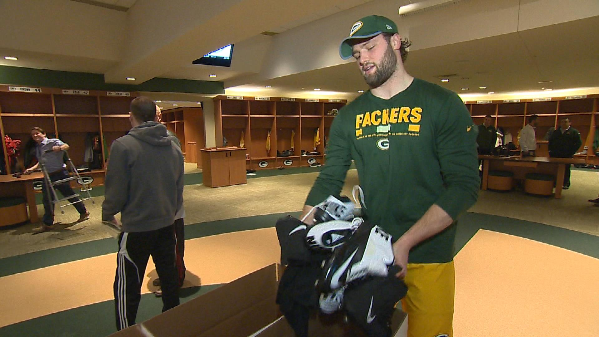 Green Bay Packers linebacker Vince Biegel donates his cleats to charity in the locker room Jan. 2, 2018. (WLUK image)<p></p>