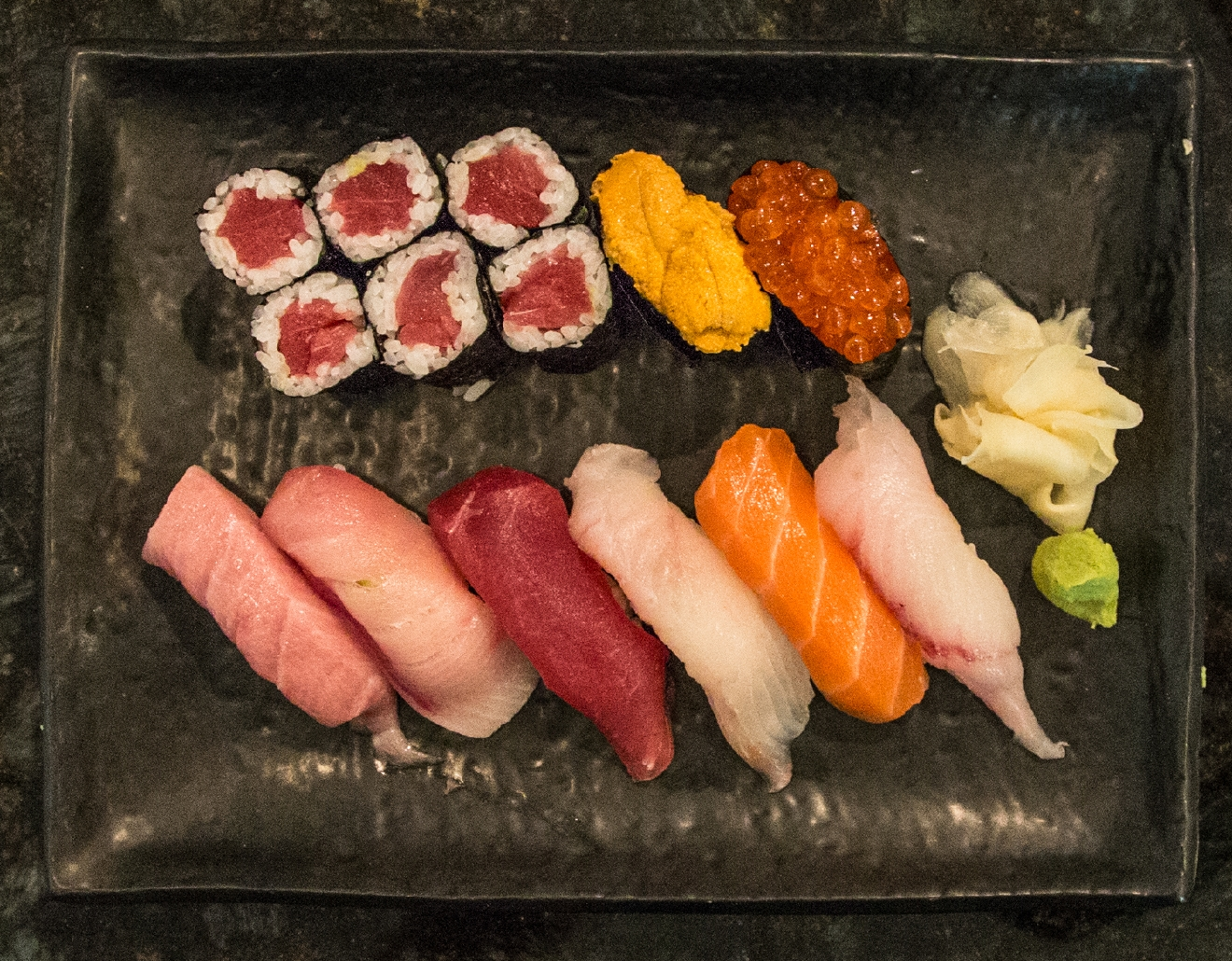 This plate features a salmon roll, a sea urchin roll, a roe roll, bluefin tuna, yellowtail, tuna, fluke, and hobo / Image: Catherine Viox