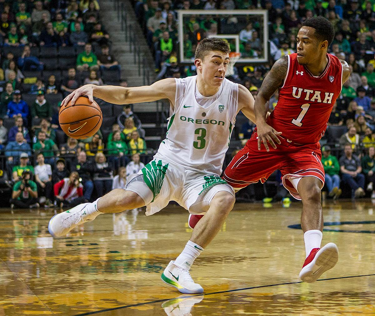 Oregon Ducks Payton Pritchard (#3) dribbles the ball past Utah's defense. The Utah Utes defeated the Oregon Ducks 66-56 on Friday night at Matthew Knight Arena. This is the first Pac-12 conference game loss at home for the Ducks since January of 2015. This also ended the five home game winning streak for the Ducks against the Utah Utes. Photo by Rhianna Gelhart, Oregon News Lab