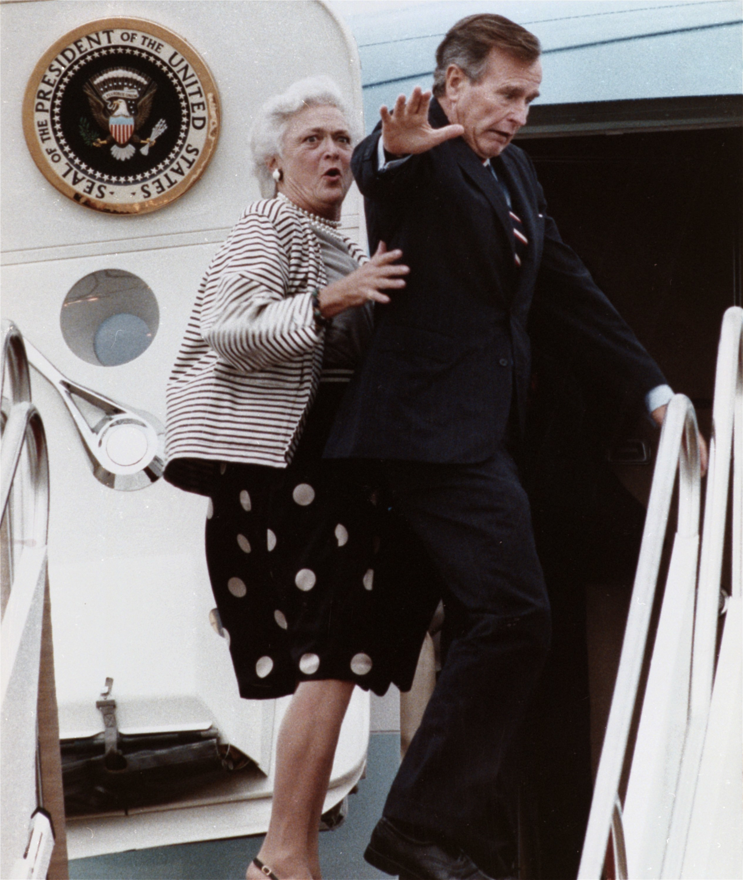 "FILE - In this Sept. 22, 1989, file photo, first lady Barbara Bush reacts after President George H.W. Bush accidentally stepped on her toe while boarding Air Force One at Andrews Air Force Base, Md., for a flight to New Jersey. Former first couple George and Barbara Bush's relationship is a true love story, described by granddaughter Jenna Bush Hager as ""remarkable."" They met at a Christmas dance. She was 17. He was 18. Two years later they were married. Now 73 years later, with Barbara Bush declining further medical care for health problems, they are the longest-married couple in presidential history. (AP Photo/Charles Tasnadi, File)"