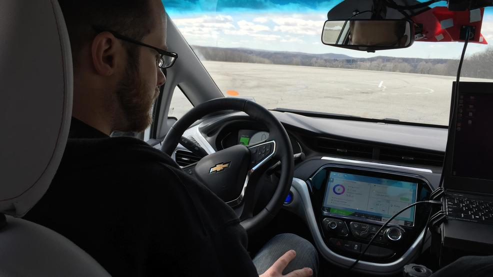 Nate Spike behind the wheel of Michigan Technological University autonomous car.JPG