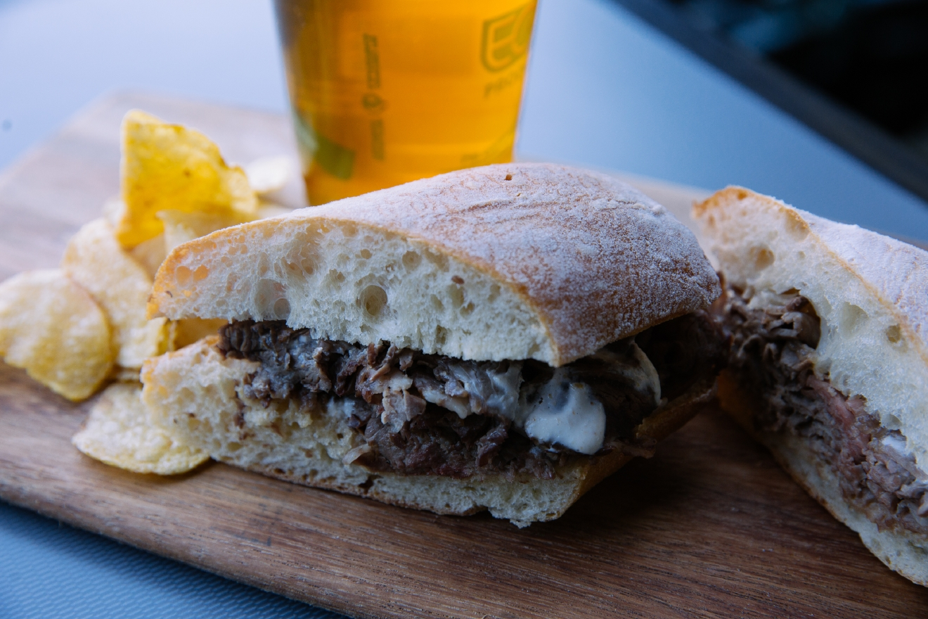Prime Rib Sandwich, $12. Shaved Rainier Ranch prime rib beef drizzled with horseradish cream, served on a Franz Bakery ciabatta roll. Found in Section 105. (Image: Joshua Lewis/Seattle Refined).