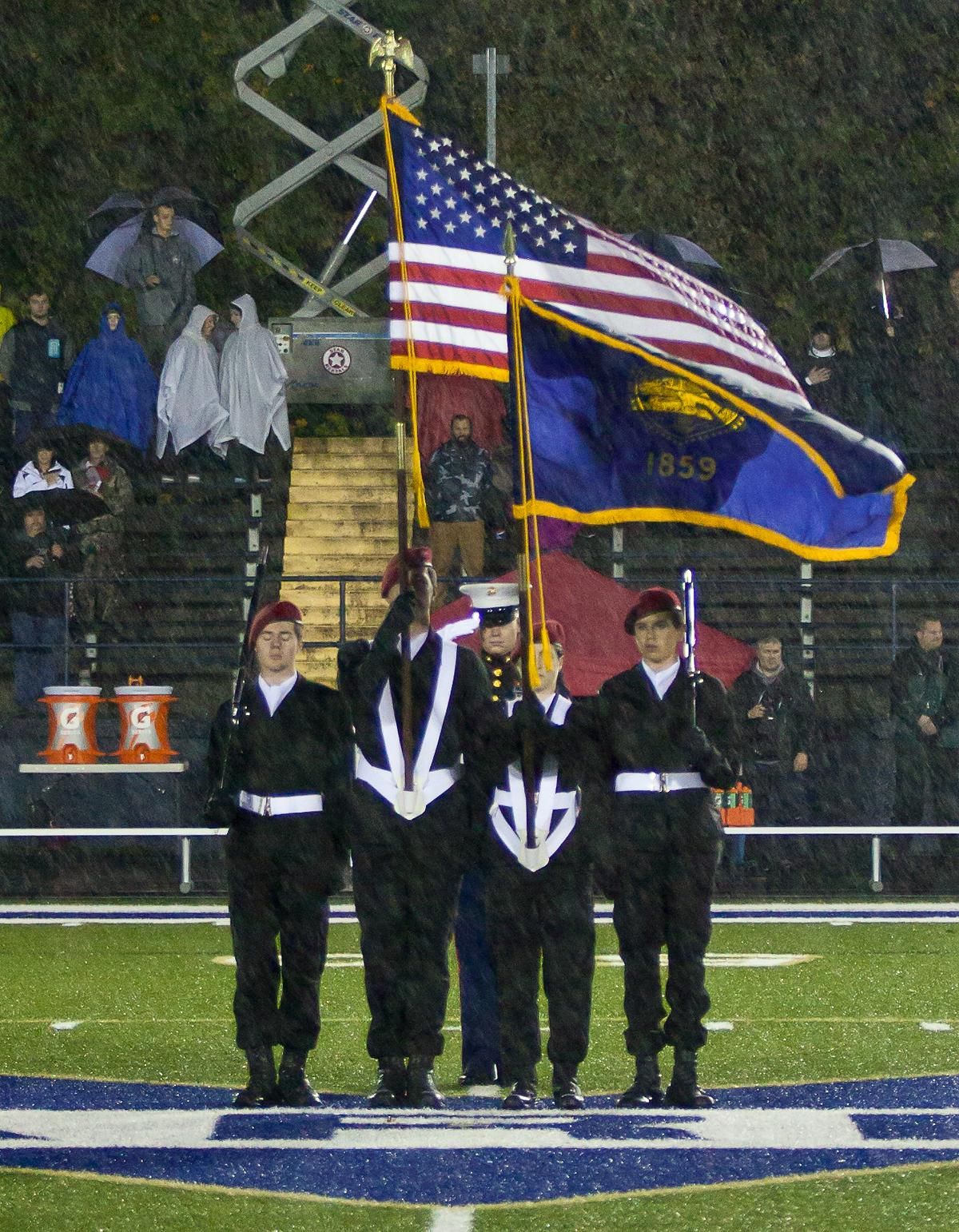 The Color Guard present the flags during the National Anthem as a part of Marist's homecoming celebration. The Marist Spartans defeated the Thurston Colts 17 to 14. Photo by Ben Lonergan, Oregon News Lab