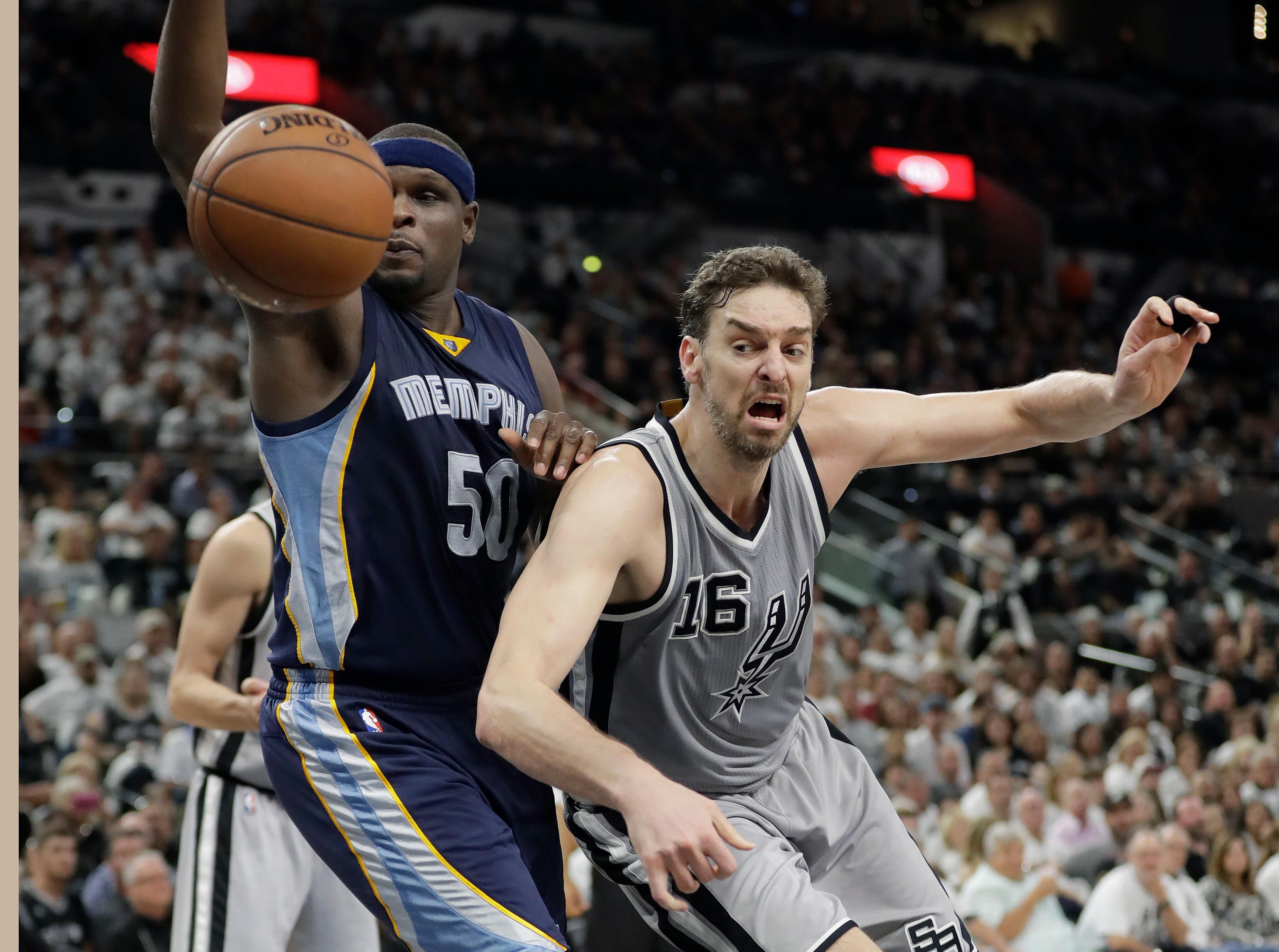 Memphis Grizzlies forward Zach Randolph (50) and San Antonio Spurs center Pau Gasol (16) chase a loose ball during the first half Game 1 in a first-round NBA basketball playoff series, Saturday, April 15, 2017, in San Antonio. (AP Photo/Eric Gay)