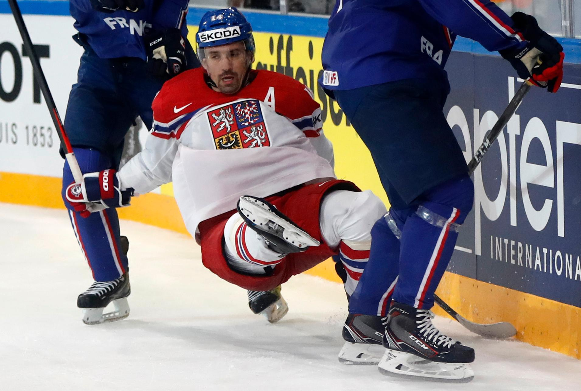 Czech Republic's Tomas Plekanec is checked during the Ice Hockey World Championships group B match between France and Czech Republic in the AccorHotels Arena in Paris, France, Sunday, May 14, 2017. (AP Photo/Petr David Josek)