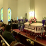 Area organization holds 'funeral' for victims of domestic violence