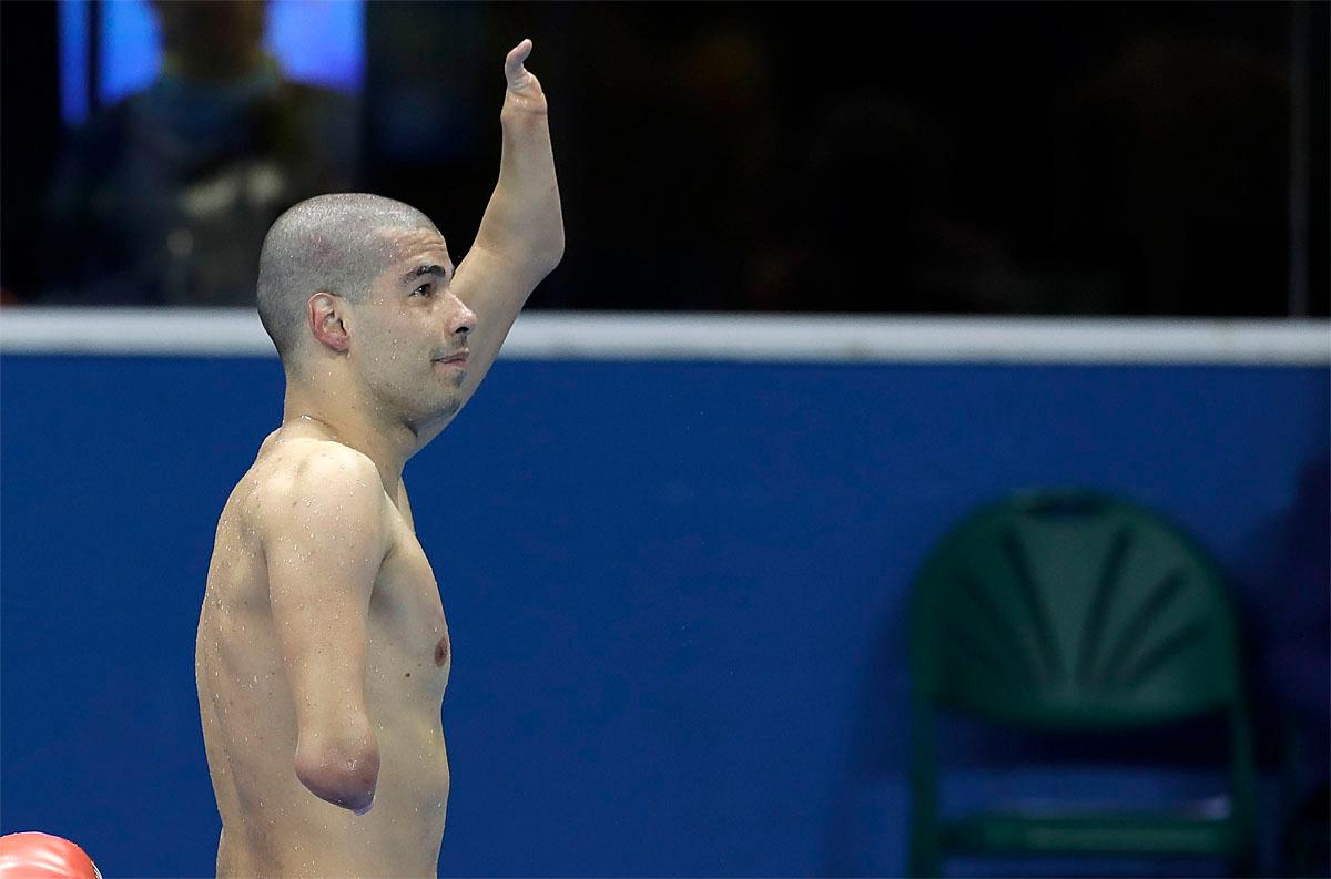 Brazil's Daniel Dias waves to the crowed after he won the men's 200-meter freestyle S5 final swimming competition at the Rio 2016 Paralympic Games in Rio de Janeiro, Brazil, Thursday Sept. 8, 2016. (AP Photo/Leo Correa)