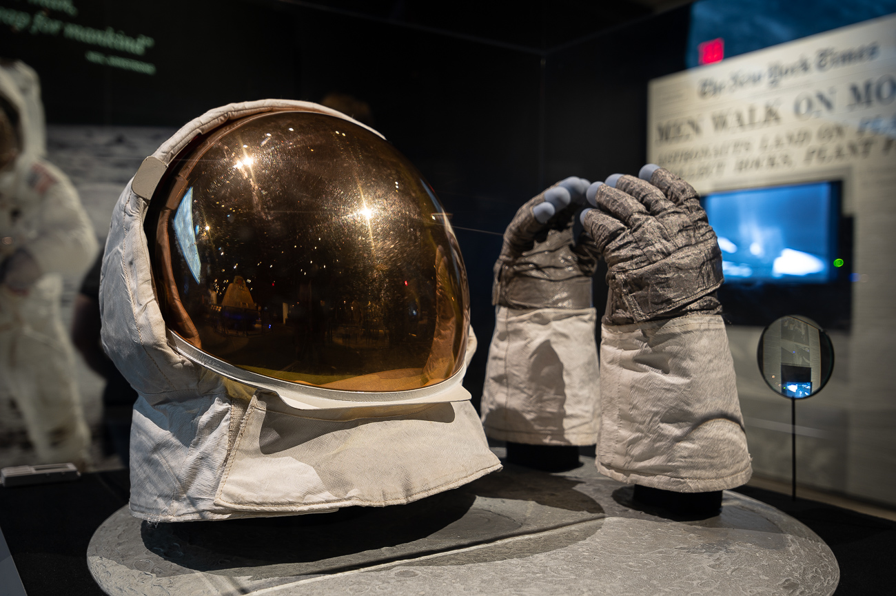 Buzz Aldrin wore this outer helmet and these gloves while on the moon. Both pieces were designed to protect Aldrin from the unfiltered light from the sun while also providing a way for the astronaut to safely interact with the moon. / Image: Phil Armstrong, Cincinnati Refined // Published: 10.2.19