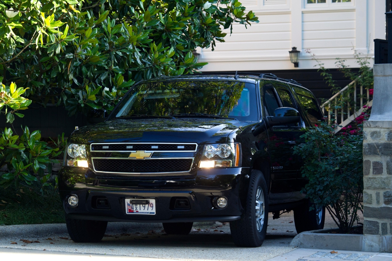 A SUV depart the home of Democratic presidential candidate Hillary Clinton in Washington, Saturday, July 2, 2016. The Clinton campaign says the FBI interviewed Clinton on Saturday morning in Washington, about her emails while she was secretary of state. (AP Photo/Cliff Owen)