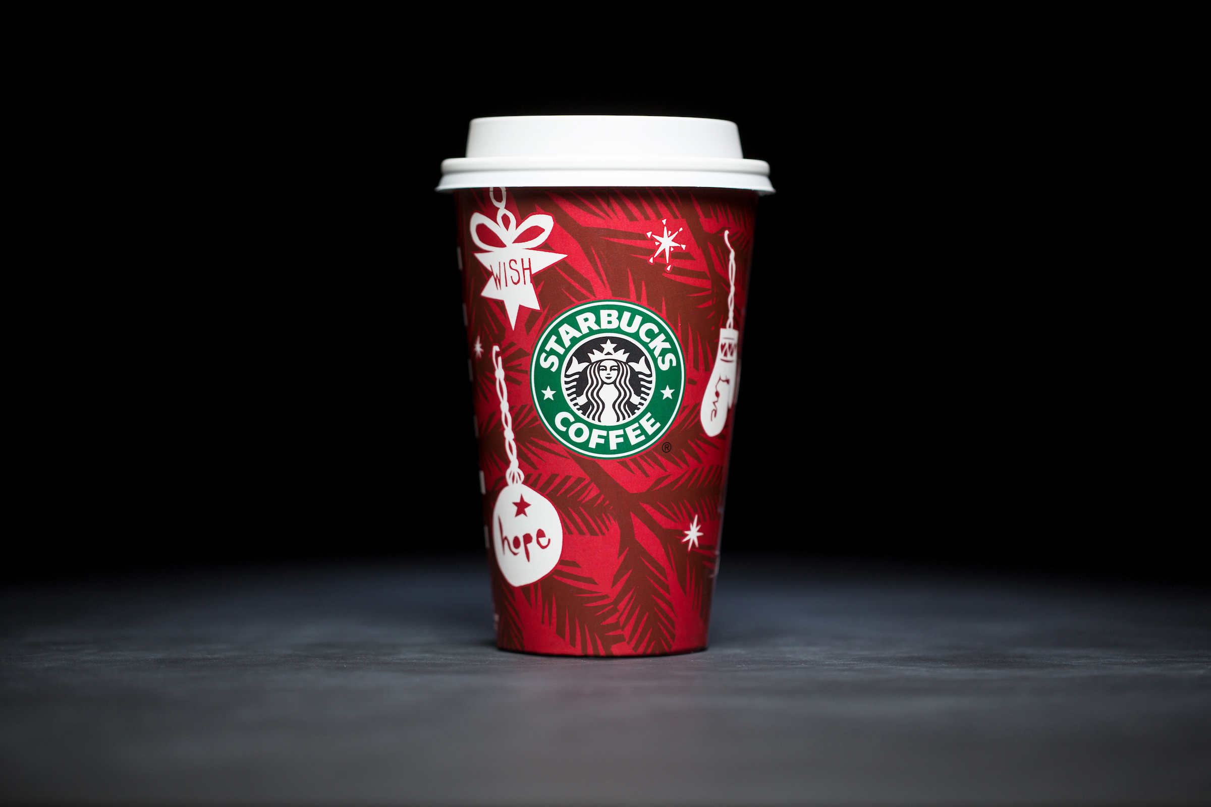 2009: For 20 years, Starbucks have released a range of holiday cup designs, most of them based around their world famous red cup. It's not easy to find the very first Starbucks holiday cups, which made their debut in stores in 1997. Few were saved, and electronic design files were lost in an earthquake in 2001. Even an Internet search is unyielding, with the cups having made their arrival long before the first selfie. But, we have them here! Click on for a photos of all 20 holidays cup designs. (Image: Joshua Trujillo/Cover Images)