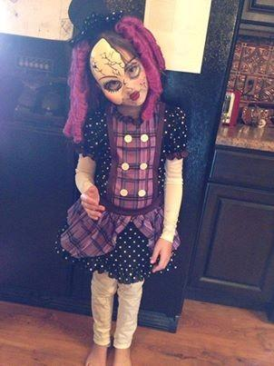 Paige, age 8, she's a broken doll!!