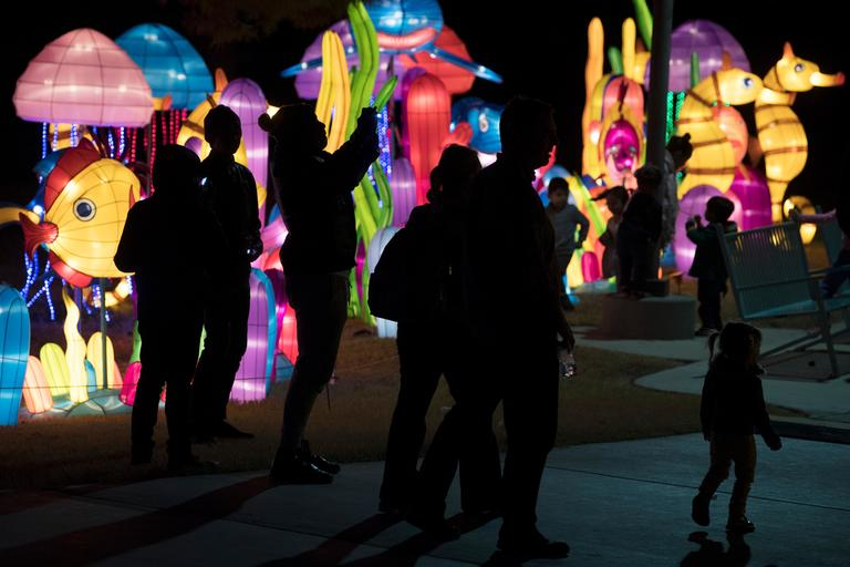 People are seen in silhouette on the opening night of the China Lights lantern festival Friday, January 19, 2018, at Craig Ranch Regional Park in North Las Vegas. The festival, which features nearly 50 silk and LED light displays comprised of over 1000 elements, runs through February 25th. CREDIT: Sam Morris/Las Vegas News Bureau