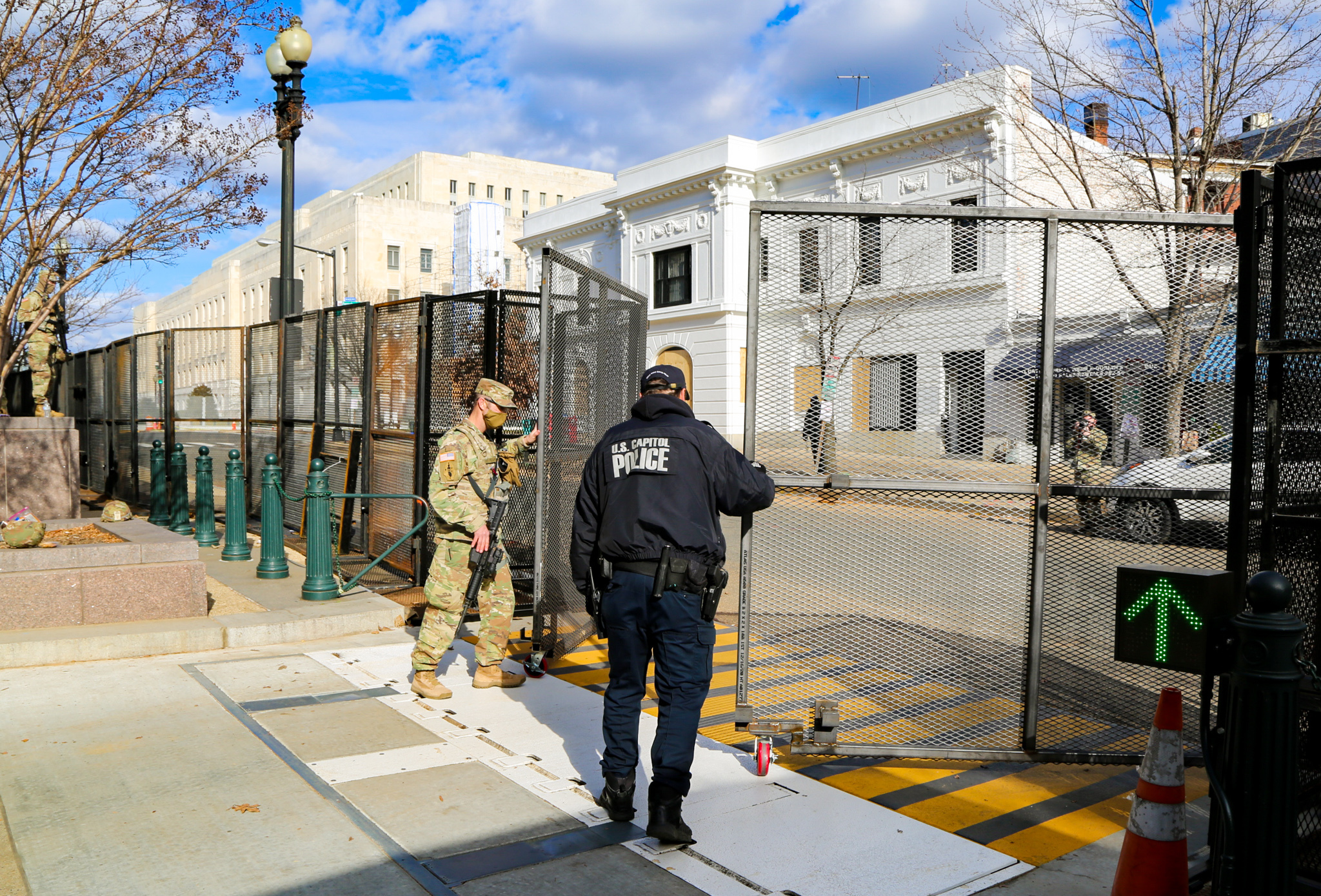 U.S. Soldiers with the Utah National Guard assists local authorities in securing a vehicle entry point, in Washington, D.C., Jan. 18, 2021. At least 25,000 National Guard men and women have been authorized to conduct security, communication and logistical missions in support of federal and District authorities leading up and through the 59th Presidential Inauguration. (U.S. Army National Guard photo by Spc. Christopher Hall)