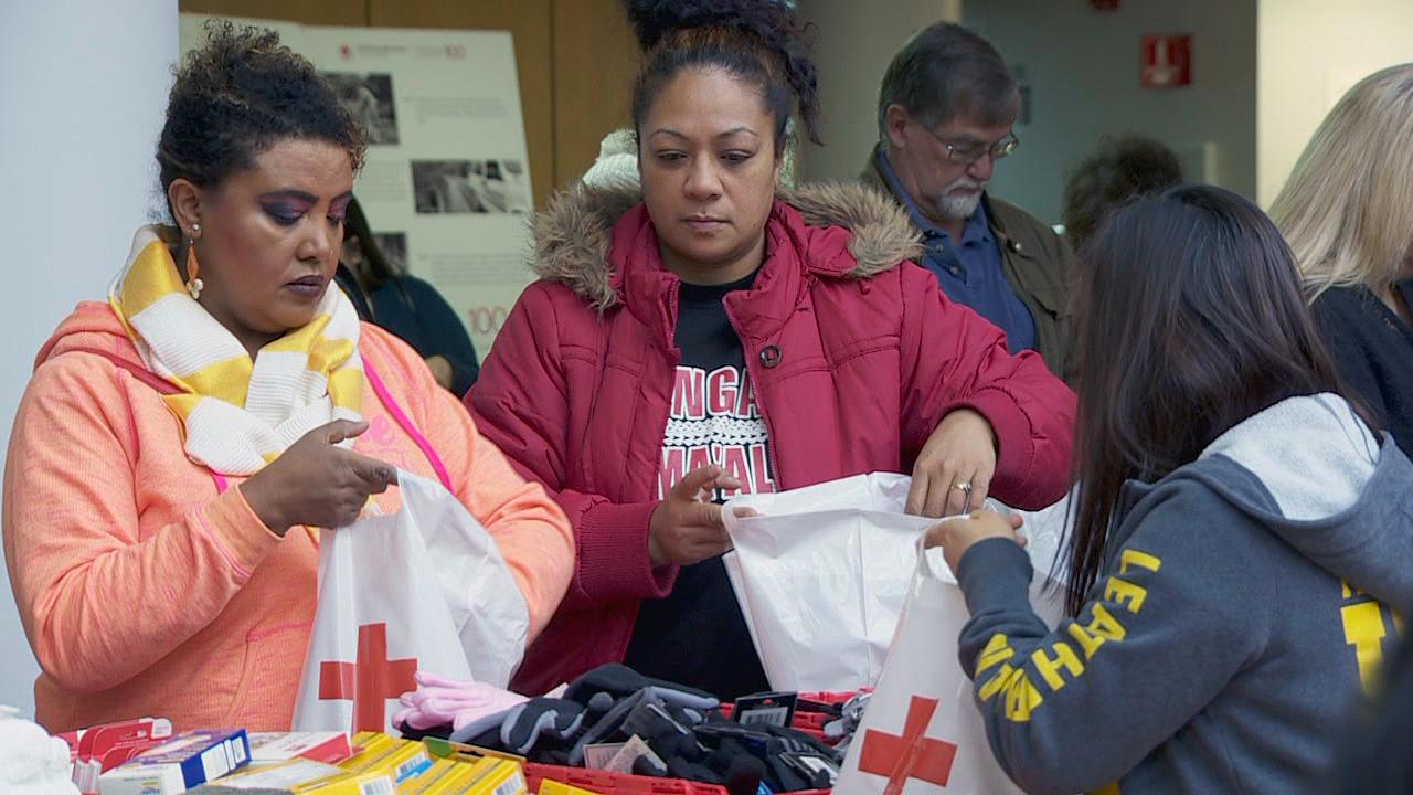 Red Cross volunteers pack comfort kits for veterans in need Friday, Nov. 10, 2017. (KATU Photo)