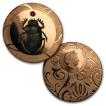 <p>Though only one coin in this triad has the honor of housing rhodium, the Desert Heat Scarab Selection coin set is priced exceptionally well. The Red Dawn coin boasts a single black rhodium scarab on the reverse who is shown holding up the red sun portrayed by a single red SWAROVSKI crystal. Valued at $359.99</p>