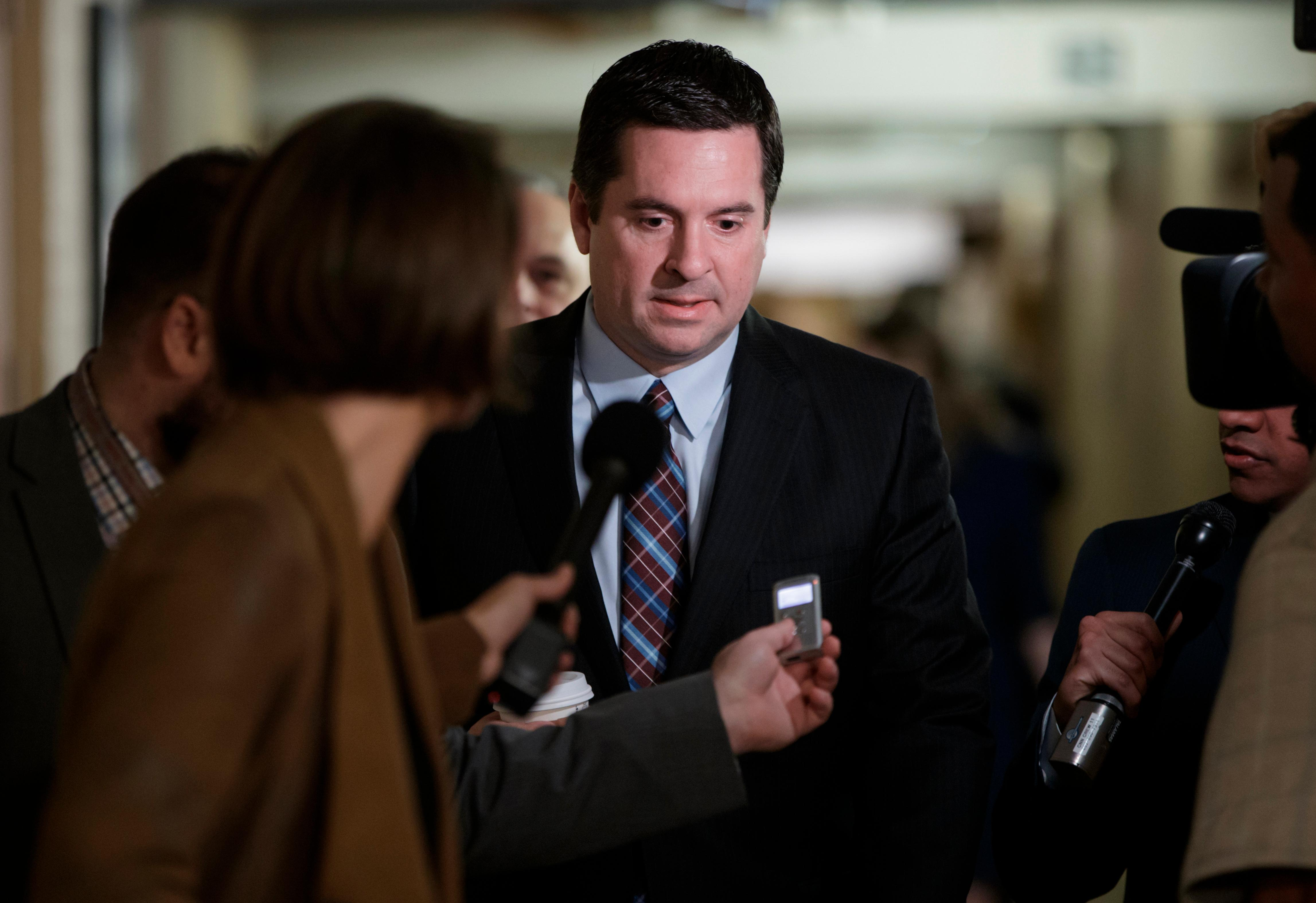 FILE - In this March 28, 2017 file photo, House Intelligence Committee Chairman Rep. Devin Nunes, R-Calif. is pursued by reporters on Capitol Hill in Washington. Nunes says he's temporarily stepping aside from Russia probe amid ethics accusations.  (AP Photo/J. Scott Applewhite, File)