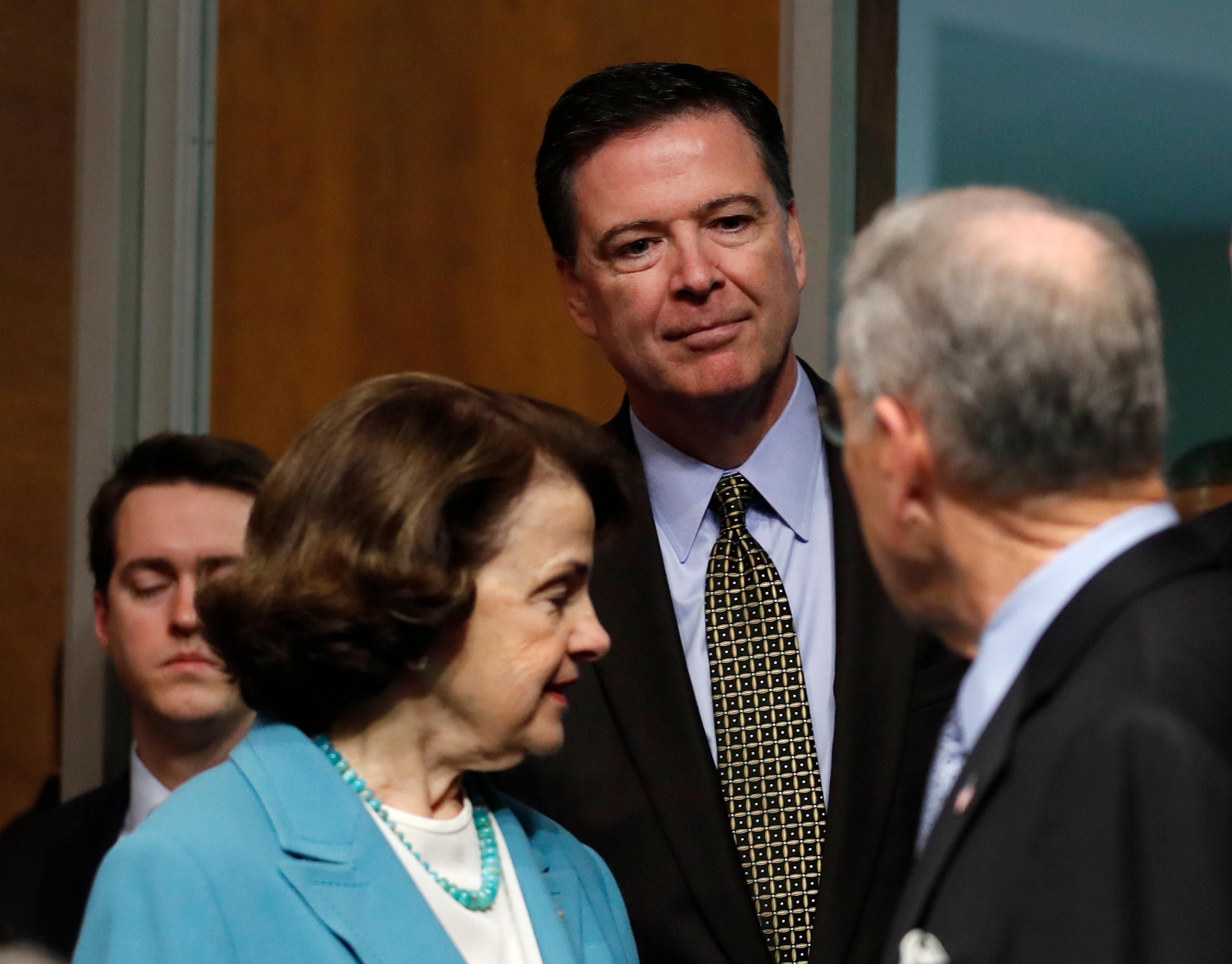 "FBI Director James Comey, flanked by Senate Judiciary Committee Chairman Sen. Charles Grassley, R-Iowa, right, and the committee's ranking member Sen. Dianne Feinstein, D-Calif., arrives on Capitol Hill in Washington, Wednesday, May 3, 2017, to testify before the committee's hearing: ""Oversight of the Federal Bureau of Investigation."" (AP Photo/Carolyn Kaster)"