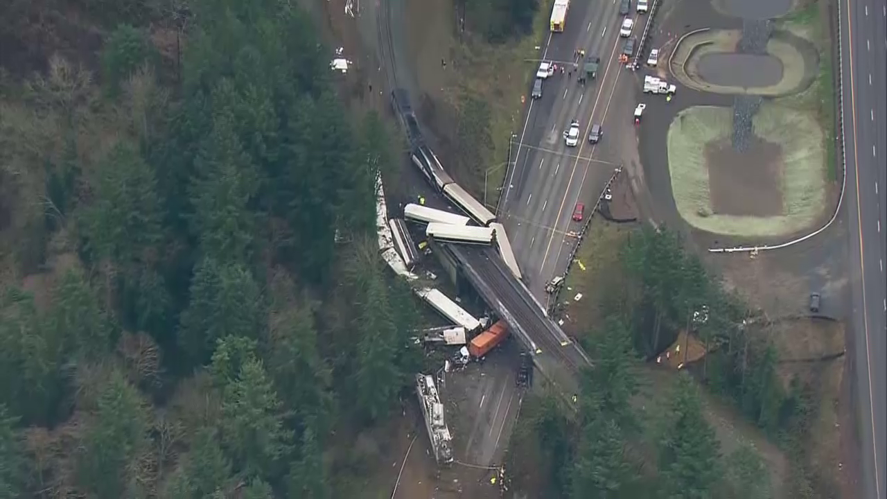 Aerial image of an Amtrak train that derailed and dove off an overpass onto lanes of Interstate 5 southbound, north of Olympia, Washington Monday morning.<p></p>