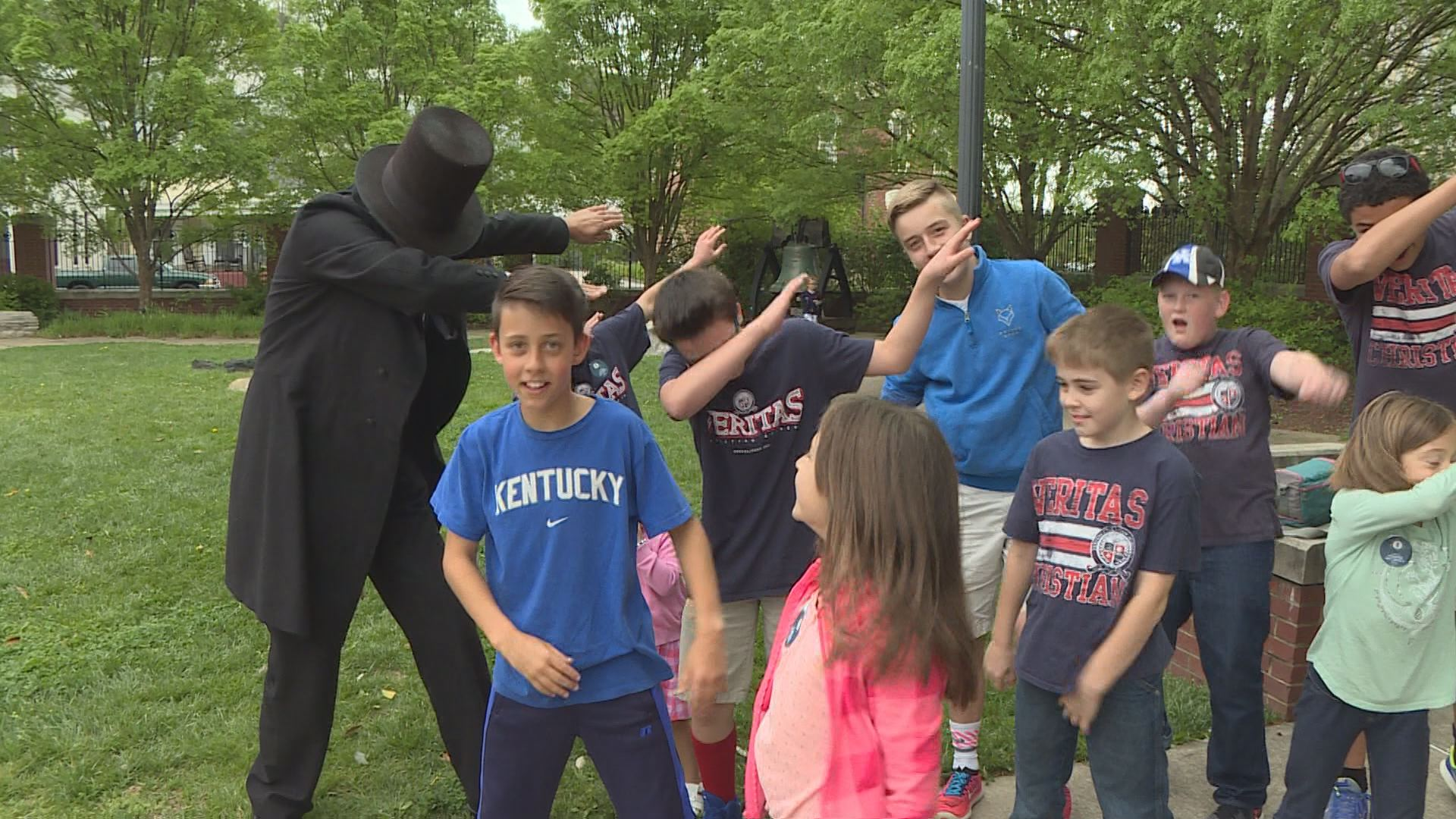 "Presenter Ron Carley of Detroit struck the popular ""dab"" pose with children outside Frankfort's Kentucky History Center."
