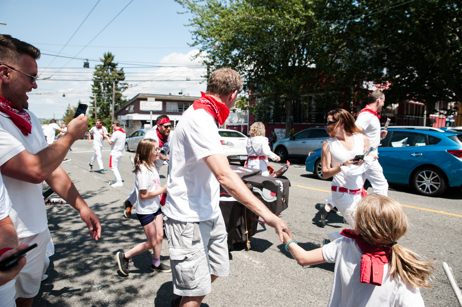 Locals donned white tops, white pants, red scarves and fast shoes to participate in the 10th annual Running of the Bulls along Queen Anne Avenue, hosted by the Comstock Commission. Rally point was Eviva Pizza, where the party started around 11 a.m. on Saturday, July 13.{ } The quick, 15 minute run took place around 1 p.m. - and it's safe to say there were MUCH fewer injuries than in Pamplona. (Image: Elizabeth Crook / Seattle Refined)