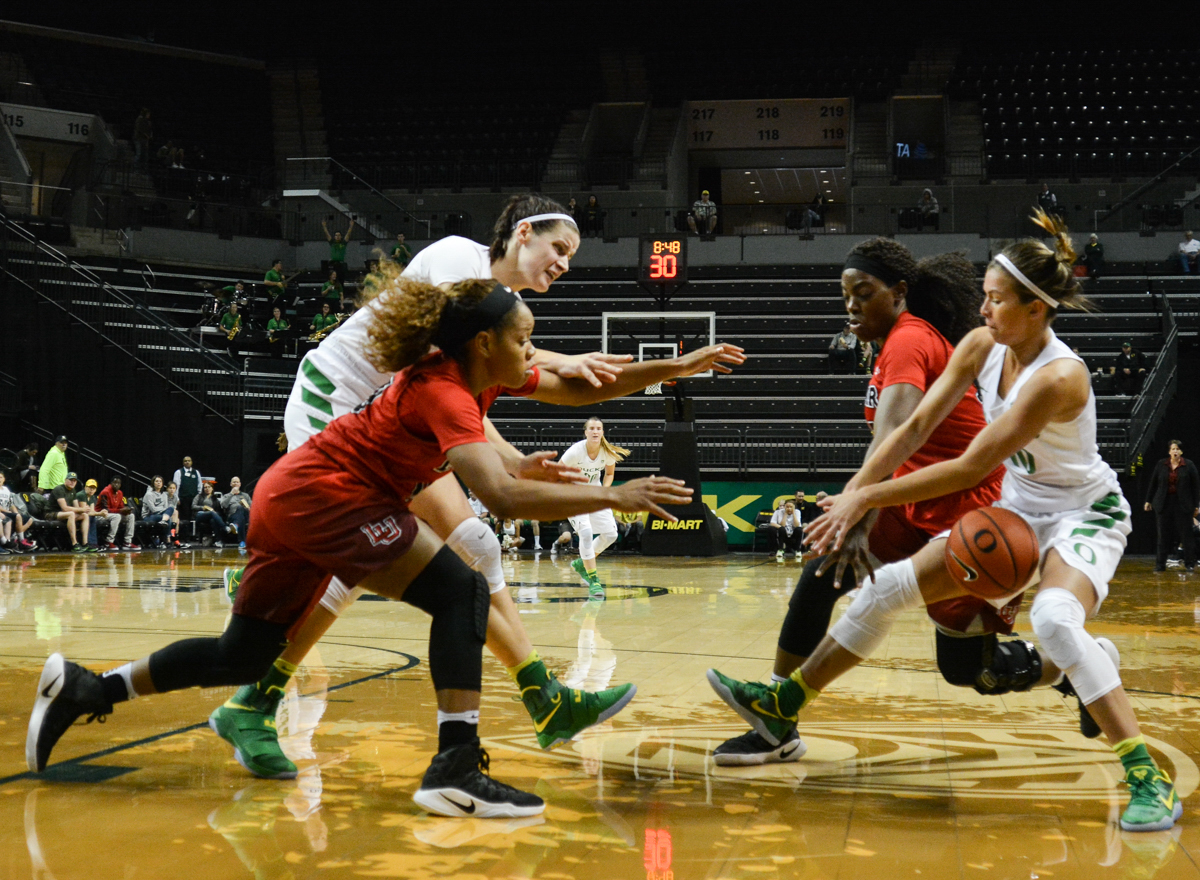 Ducks Lexi Bando (#10) fights for the rebound. The Oregon Ducks women's basketball team won their season opener against the Lamar Cardinals 84-67. Photo by Jacob Smith, Oregon News Lab