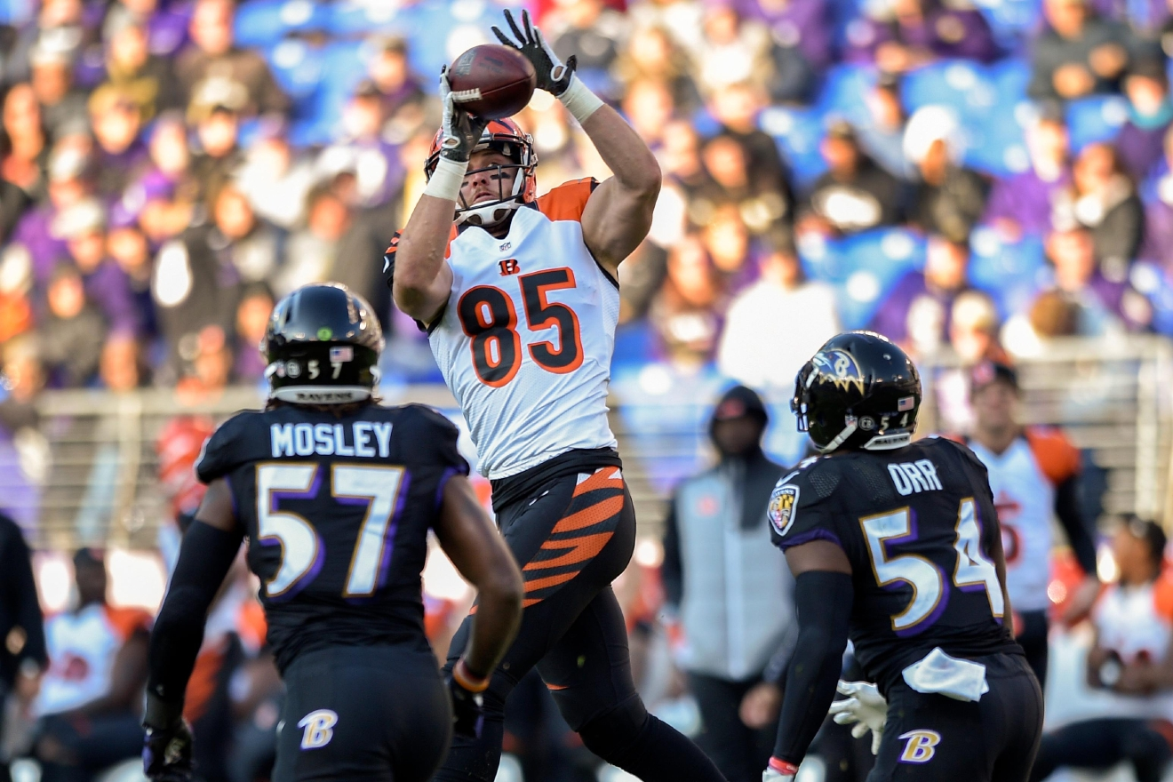 Cincinnati Bengals tight end Tyler Eifert (85) leaps over Baltimore Ravens inside linebacker C.J. Mosley (57) an dinside linebacker Zach Orr (54) to pull in a pass during the second half of an NFL football game in Baltimore, Sunday, Nov. 27, 2016. (AP Photo/Nick Wass)