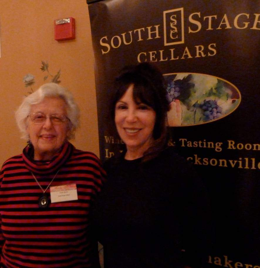 Traute Moore and Porscha Schiller of South Stage Cellars pour wine at the 31st Annual JPR Wine Tasting at the Ashland Springs Hotel Dec. 8