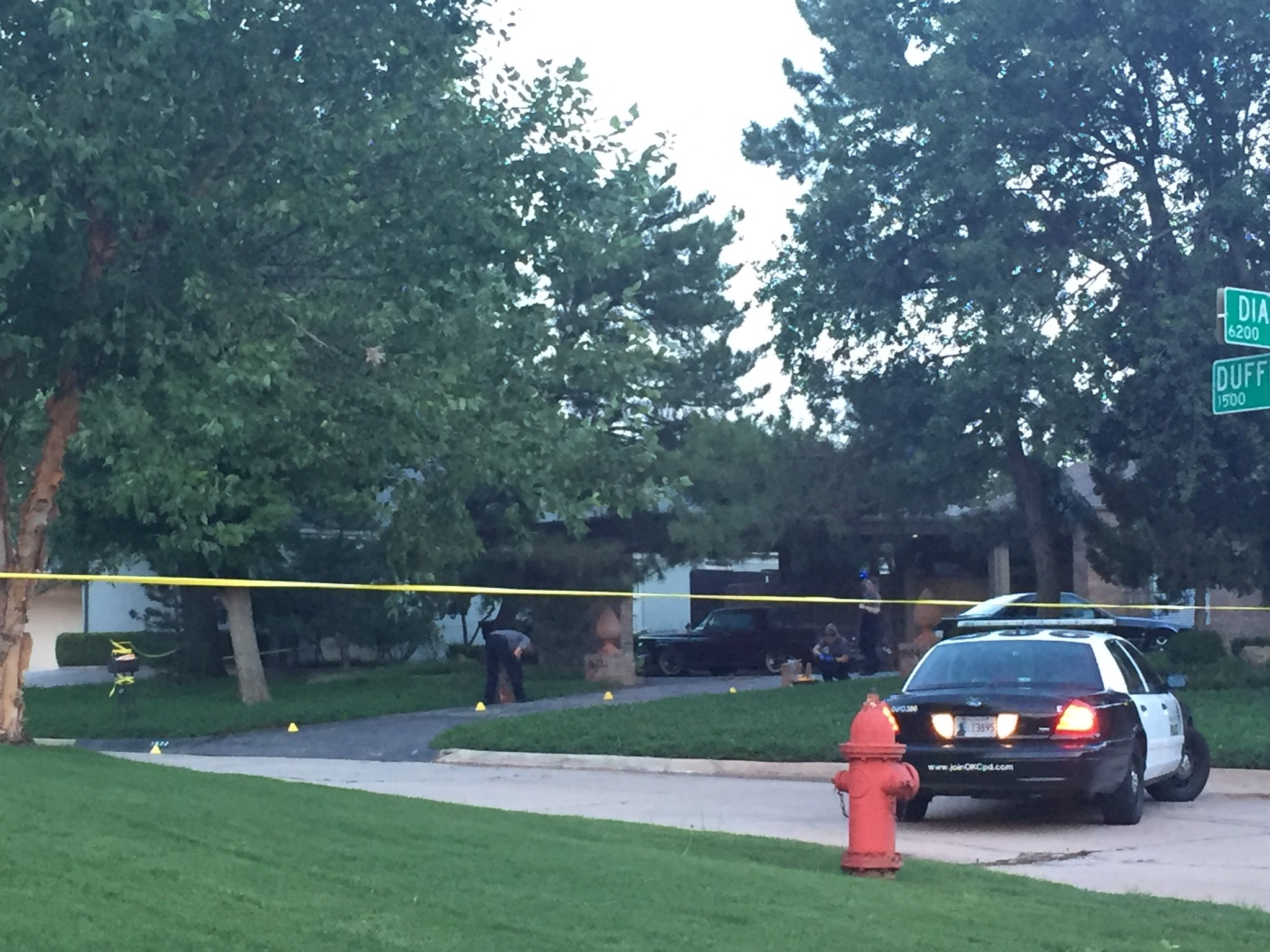 CSI gathering evidence on the driveway of the home. (Jordann Lucero / KOKH)