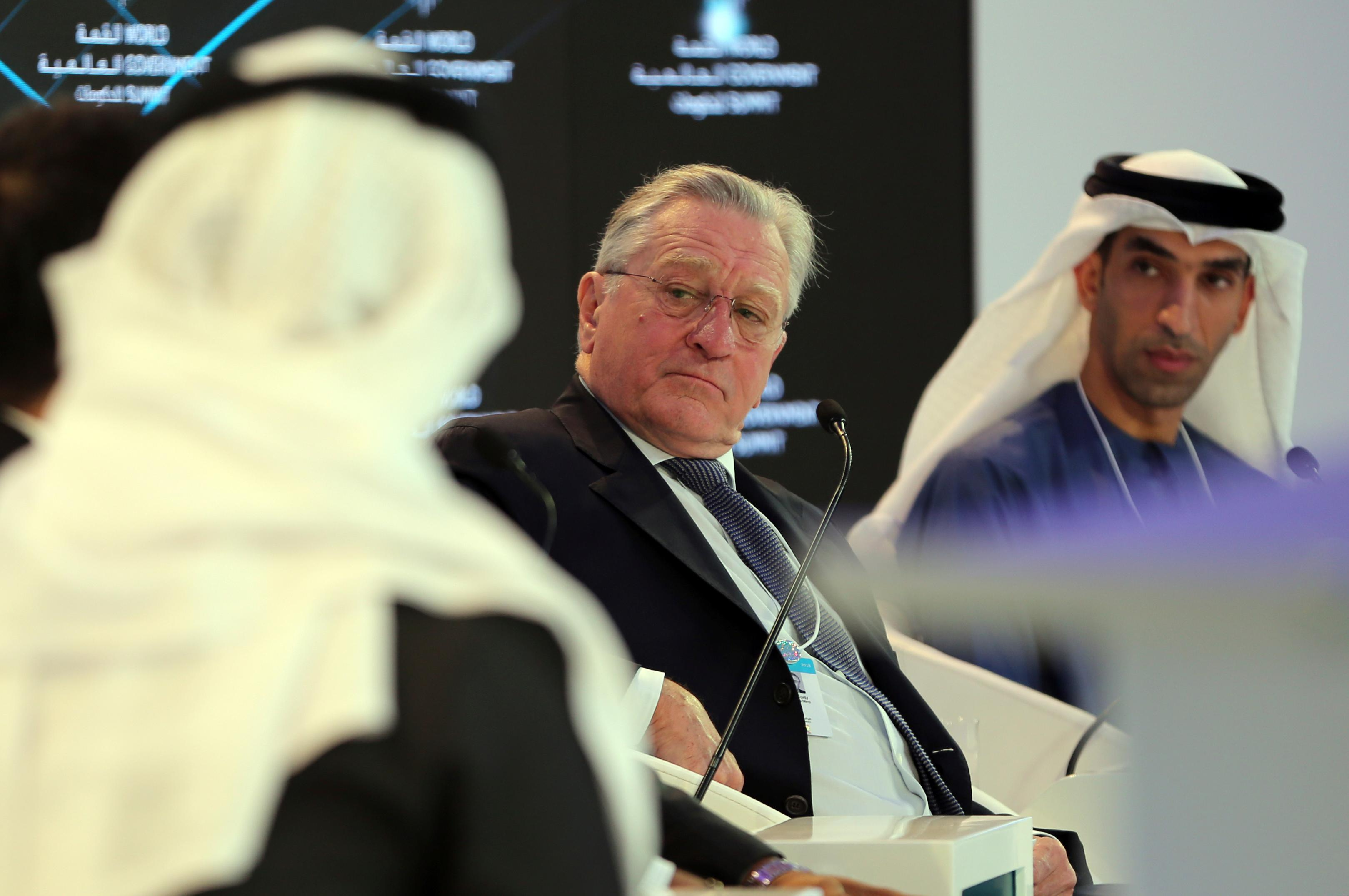 "American Hollywood star Robert De Niro listens to one of the panel speakers next to Dr. Thani Ahmed Al Zeyoudi, right, the UAE Minister of Climate Change and Environment during the World Government Summit in Dubai, United Arab Emirates, Sunday, Feb. 11, 2018. De Niro took aim at the Trump administration's stance on climate change, telling a packed audience that he was visiting from a ""backward"" country suffering from ""temporary insanity."" (AP Photo/Kamran Jebreili)"