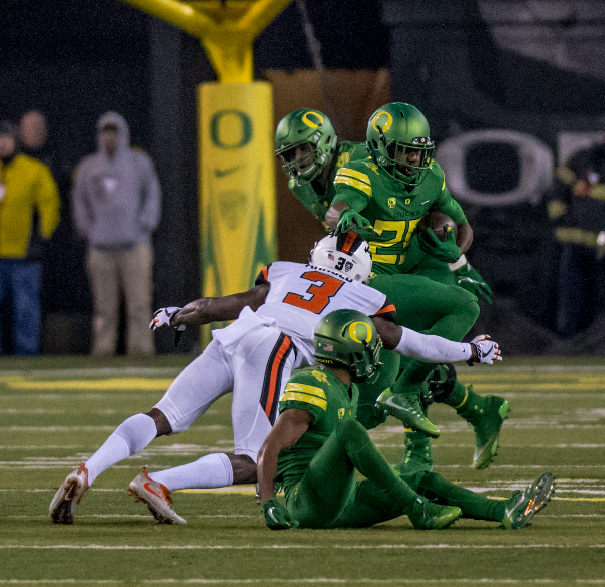 Oregon running back Kani Benoit (#29) pushes through a pack of Oregon State defenders. The Oregon Ducks defeated the Oregon State Beavers 69 to 10 in the 121st Civil War game at Autzen Stadium in Eugene, Ore. on Saturday November 25, 2017. Photo by Ben Lonergan, Oregon News Lab