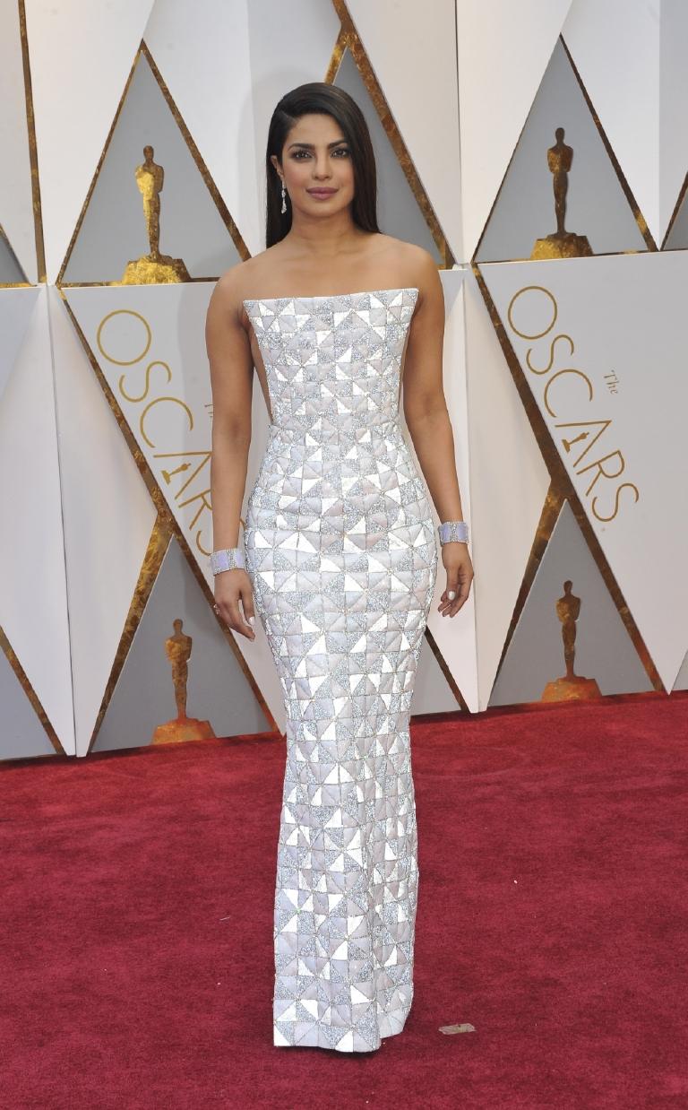 "For me this was one of those, ""do I love it or hate it"" dresses. It's a little Star Trek-y and futuristic looking, but I think I dig it. Plus, you have to admire the sculptural cut of the dress. (Image: Apega/WENN.com)"