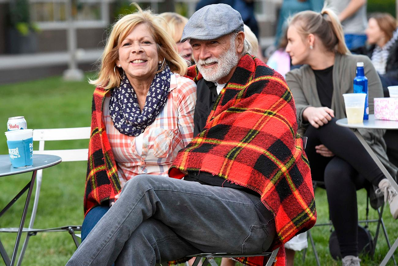 Shirley and Jim Honerkamp share a blanket on a very chilly mid-June evening / Image: Joe Simon // Published: 6.14.19