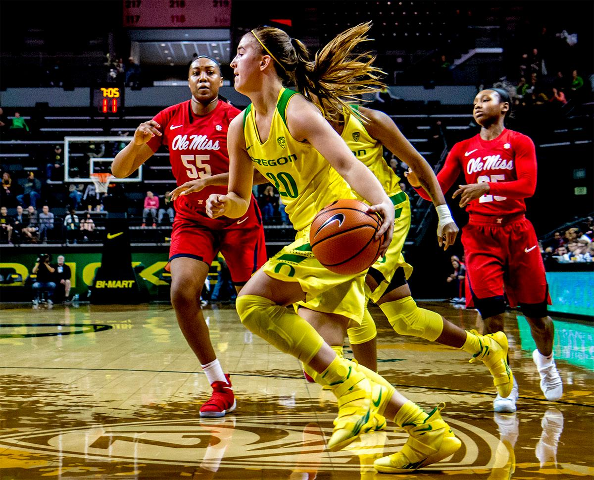 The Duck's Sabrina Ionescu (#20) runs the ball towards the basket. The Duck's Sabrina Ionescu (#20) is introduced at the start of the game against the Ole Miss Rebels. The Oregon Ducks womens basketball team defeated the Ole Miss Rebels 90-46 on Sunday at Matthew Knight Arena. Sabrina Ionescu tied the NCAA record for triple-doubles, finishing the game with 21 points, 14 assists, and 11 rebounds. Ruthy Hebard added 16 points, Satou Sabally added 12, and both Lexi Bando and Maite Cazorla scored 10 each. The Ducks will next face off against Texas A&M on Thursday Dec. 21 and Hawaii on Friday Dec. 22 in Las Vegas for Duel in the Desert before the start of Pac-12 games. Photo by August Frank, Oregon News Lab