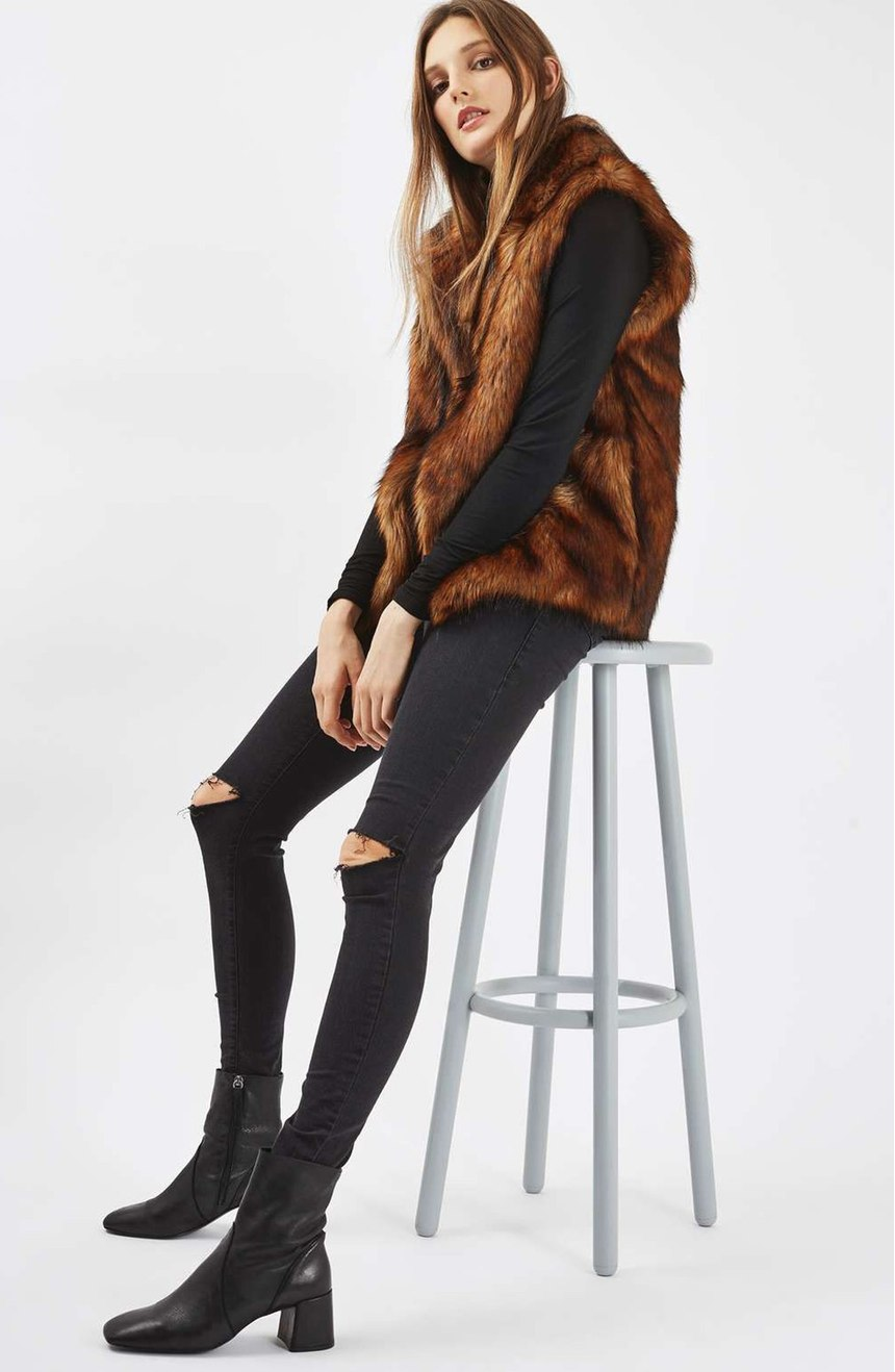 Whether it's faux or the real thing, fur's fashionability endures (depite protests). We're currently in the midst of a fur renaissance of sorts, with designers using the fluffy stuff in unexpected ways.  The hairy shoe that rose to prominence in 2016 is poised to turn heads.Try this Topshop, Faux Fur Vest ($125). 2016 was all about 90's throwback gear: chokers, thrasher tees, crop tops and dark lips.  A different decade is slated to make a comeback in 2017 and it's groovy baby.  70's era flares, over-sized fur everything and bell sleeves.  (Image: Nordstrom)